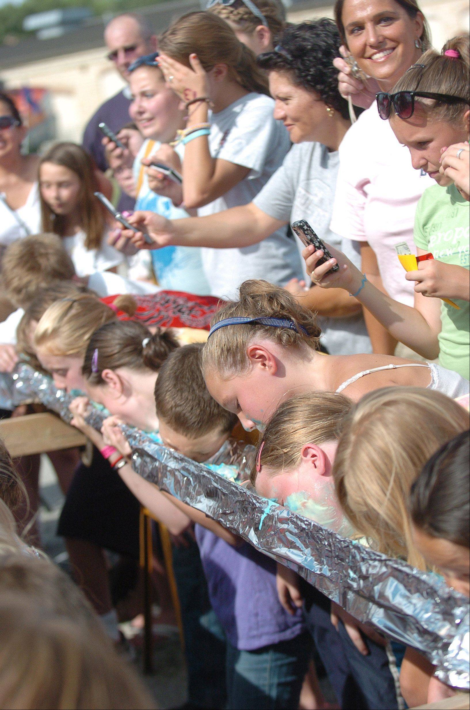 Children compete in the ice cream eating competition at last year's Windmill City Festival in Batavia.