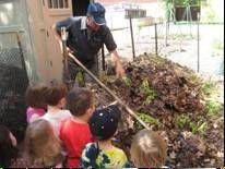 Ken Schaffer, Naturalist at Oakton Community College, explains outdoor composting with plant matter, leaves and tree branches/twigs.