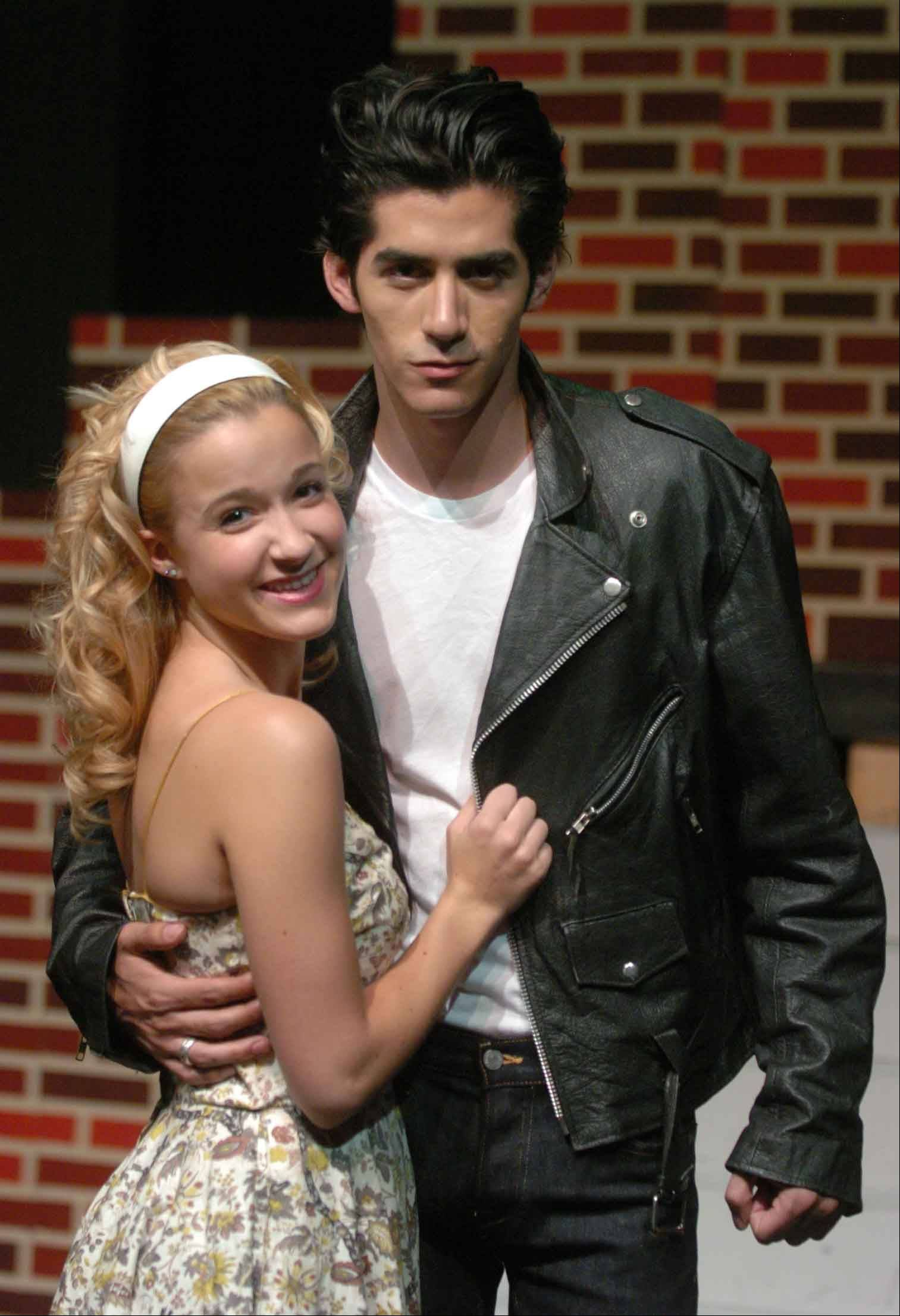 "Hannah Hudson of Downers Grove plays Sandy and Vince Soto of Chicago plays Danny in Summer Place Theatre's production of ""Grease."" The show opens at 8 p.m. Friday, July 8, and continues on weekends through July 24 at Center Stage Theater, 1665 Quincy Ave., Suite 131, Naperville."