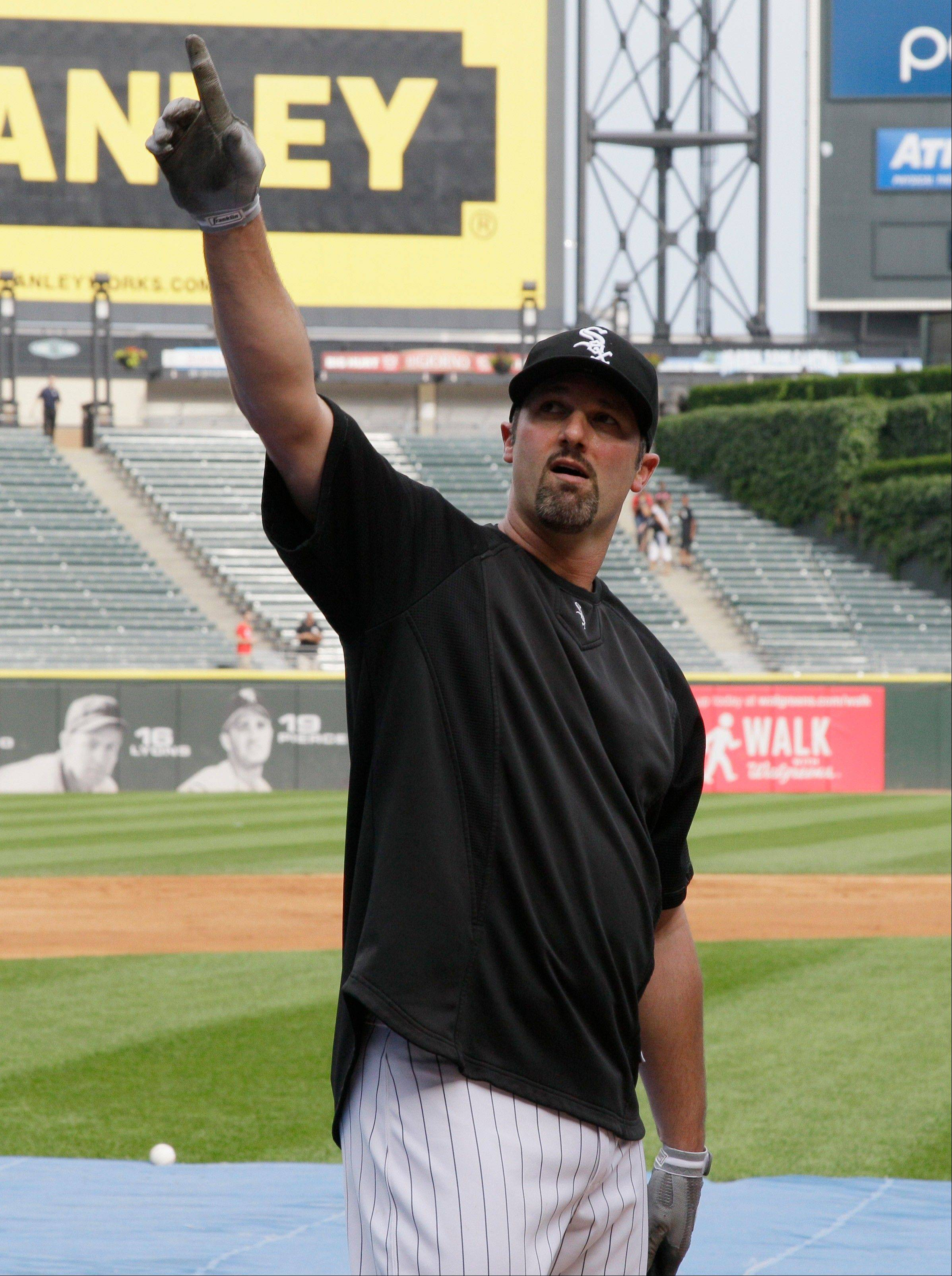 White Sox first baseman Paul Konerko points to fans at U.S. Cellular Field on Thursday after being selected as the final player for the American League all-star team.