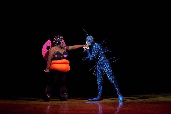"A newcomer (Barthelemy Glumineau, right) romances the Lady Bug (Michelle Matlock) in ""Ovo,"" the Cirque du Soleil show playing under the Grand Chapiteau in the United Center parking lot."