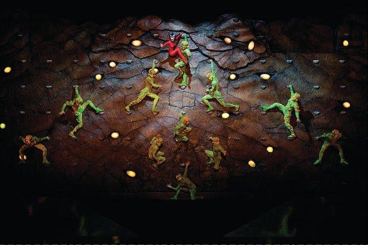 "Crickets scale a rock wall during the finale of Cirque du Soleil's ""Ovo."""