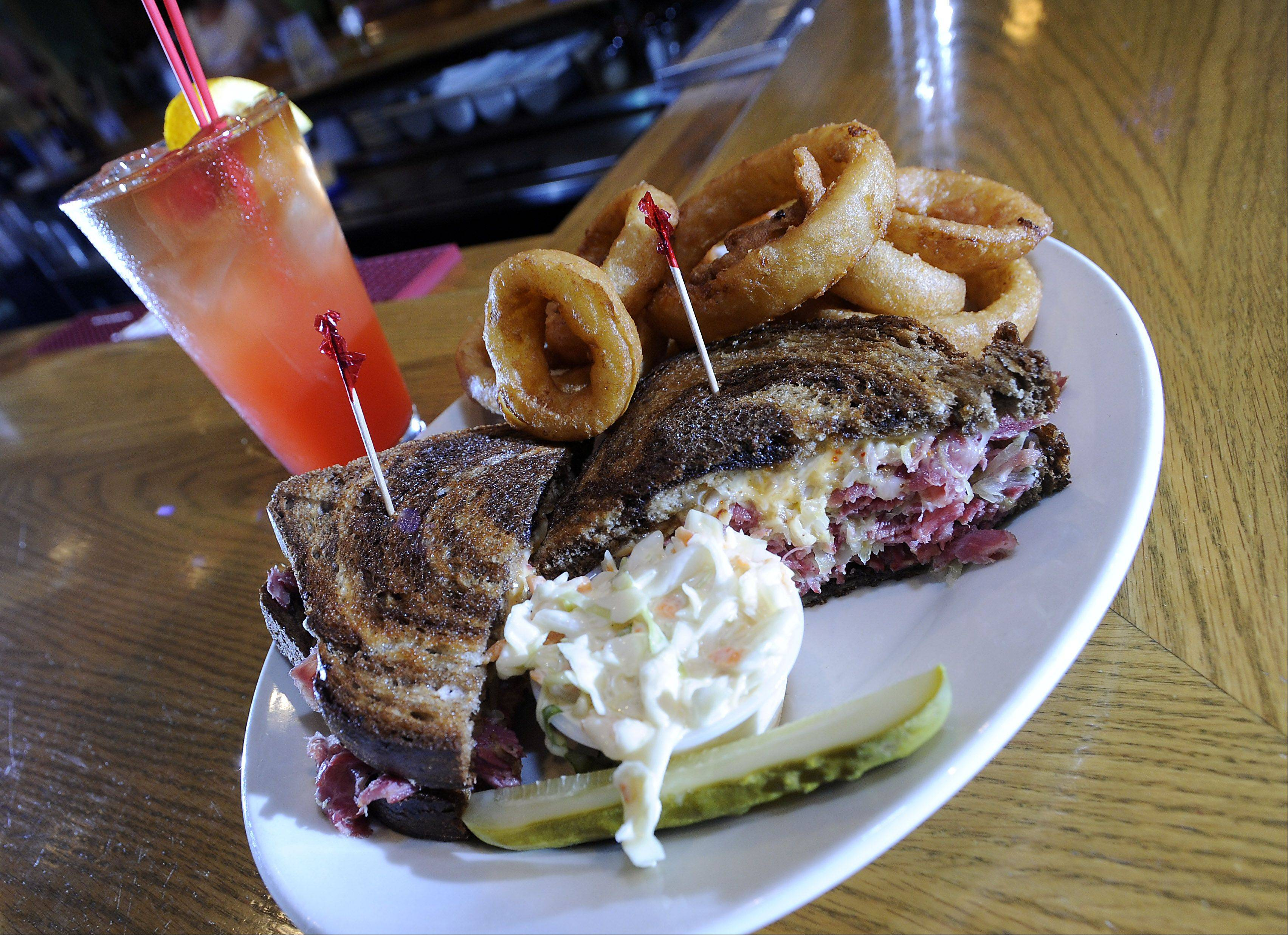 Club Casa's Reuben sandwich features corned beef, sauerkraut, cheese and dressing between slices of marble rye.