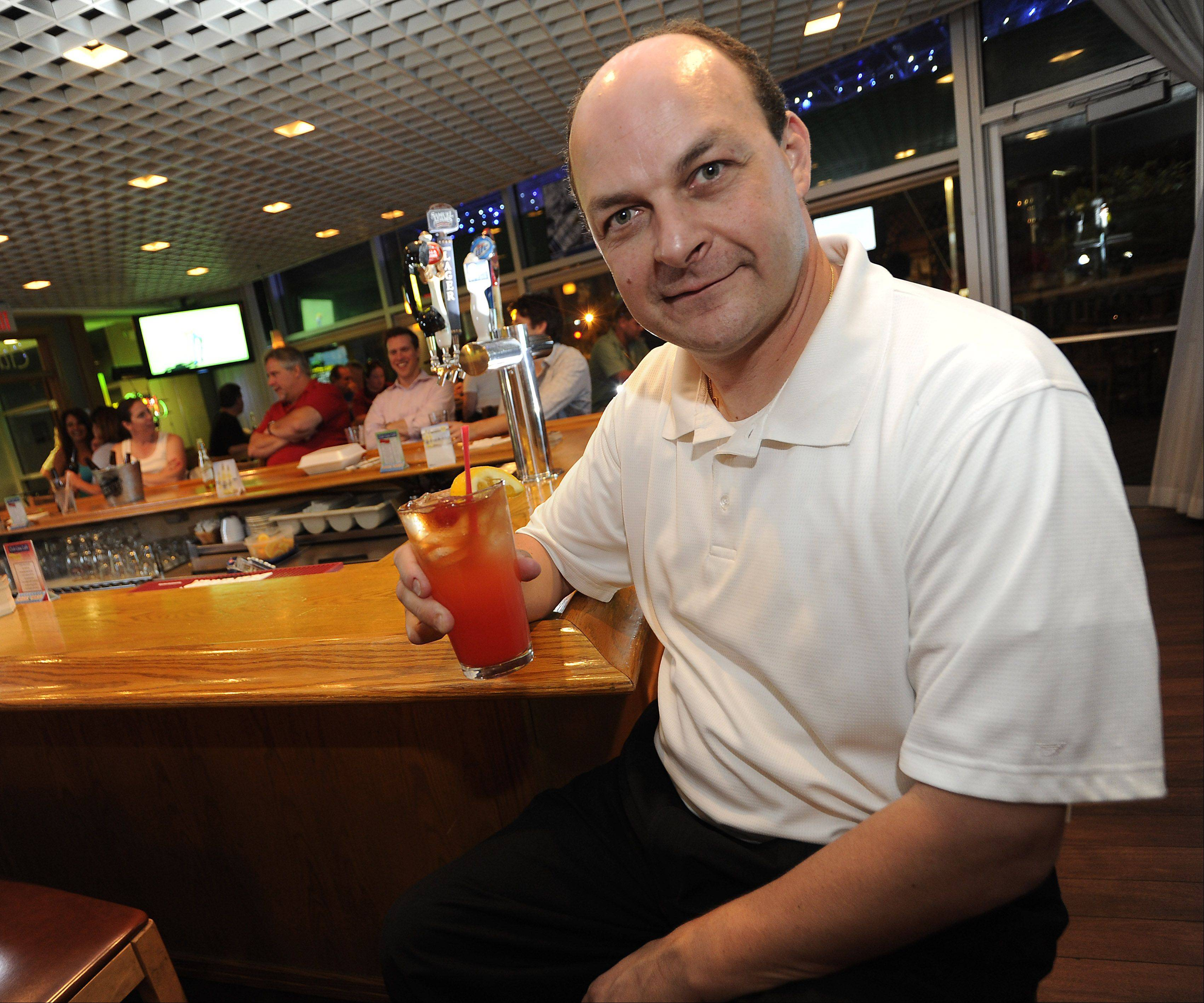 Club Casa Cafe owner Pat Ergastolo shows off his favorite drink, the Club mai tai.