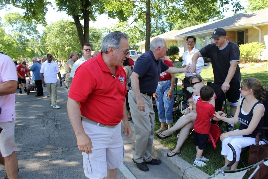 Des Plaines Mayor Marty Moylan, left, and Gov. Pat Quinn chat with spectators during the city's July Fourth parade. The governor spent last Friday discussing the gambling expansion legislation with eight suburban mayors of casino towns.