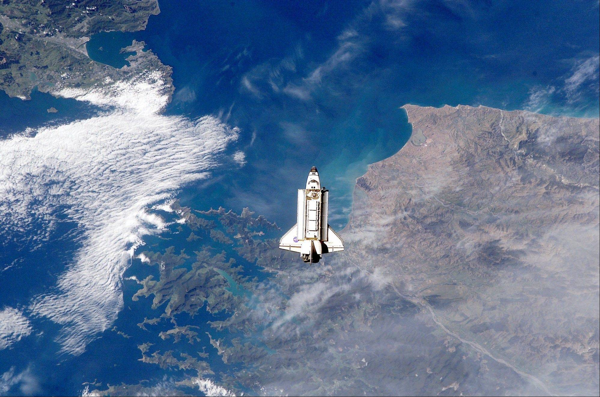 This Monday, Nov. 25, 2002 file picture shows the space shuttle Endeavour over New Zealand as it approaches the International Space Station for docking.