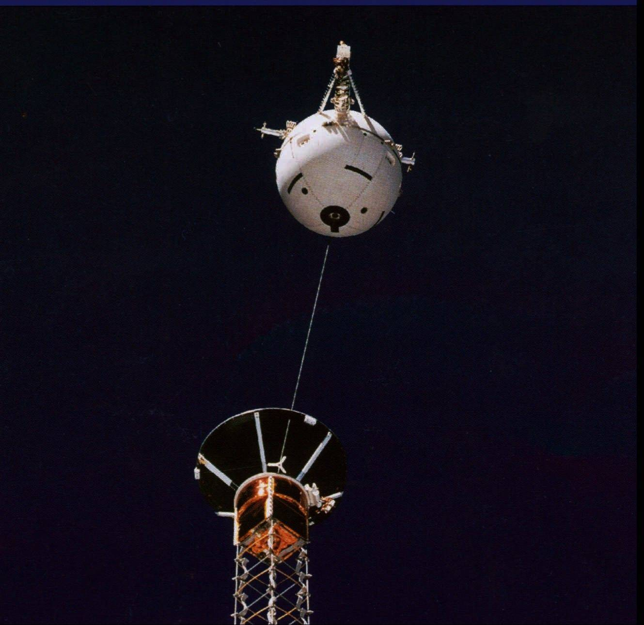 FILE - This July 1992 file picture provided by NASA shows the Tethered Satellite System during an experiment on the space shuttle Atlantis. On Sunday, Feb. 25, 1996, the Italian satellite, which was attached to the space shuttle Columbia, floated off into space after its cable broke.