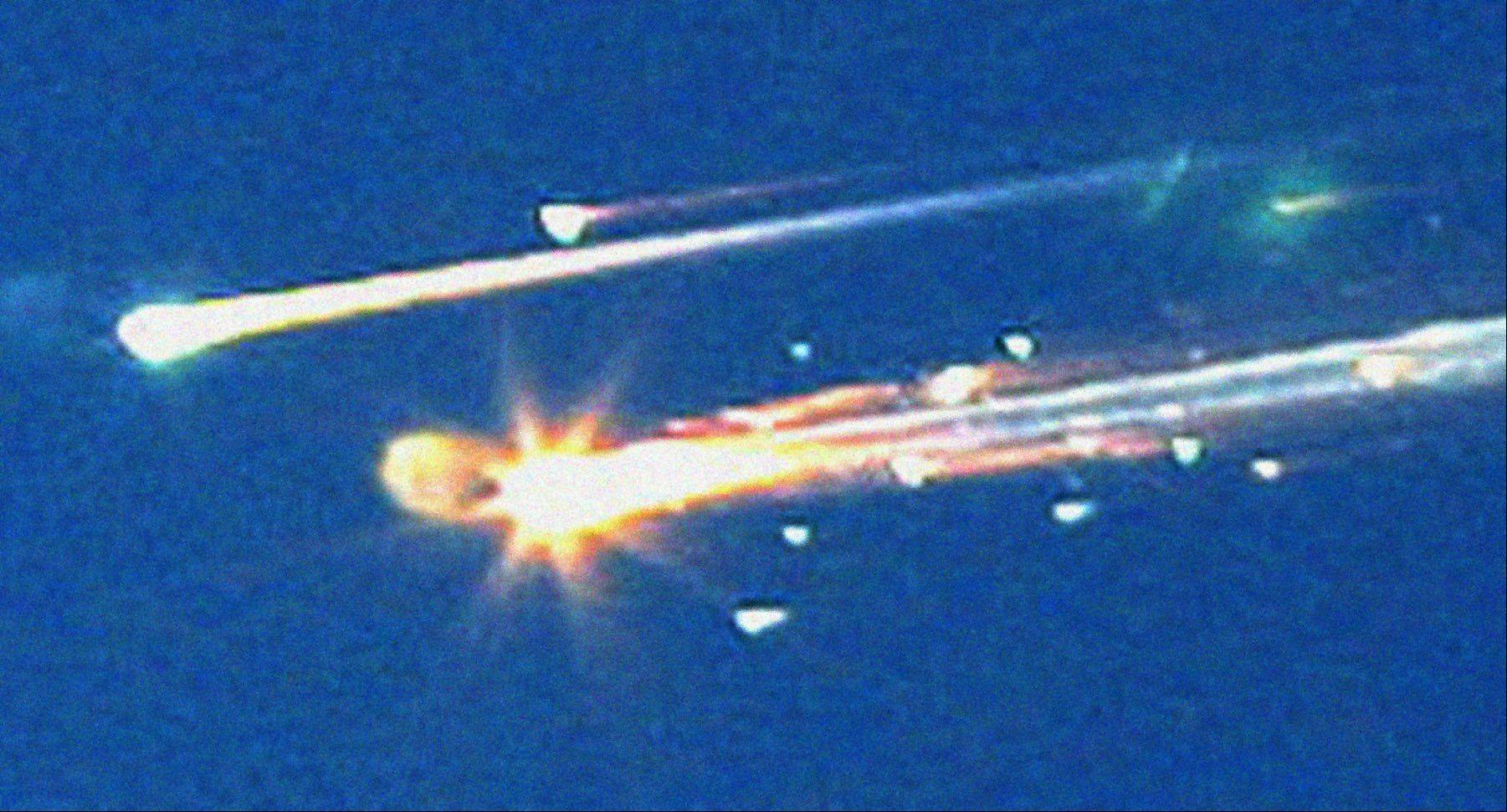 In this Saturday, Feb. 1, 2003 file photo, debris from the space shuttle Columbia streaks across the sky over Tyler, Texas.