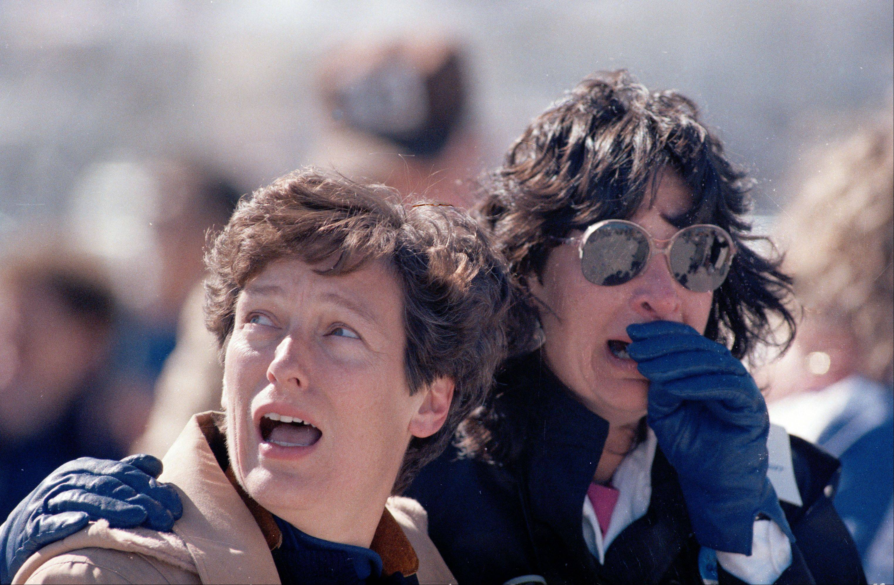 In this Jan. 28, 1986 file picture, two unidentified spectators at the Kennedy Space Center in Cape Canaveral, Fla. react after they witnessed the explosion of the space shuttle Challenger.