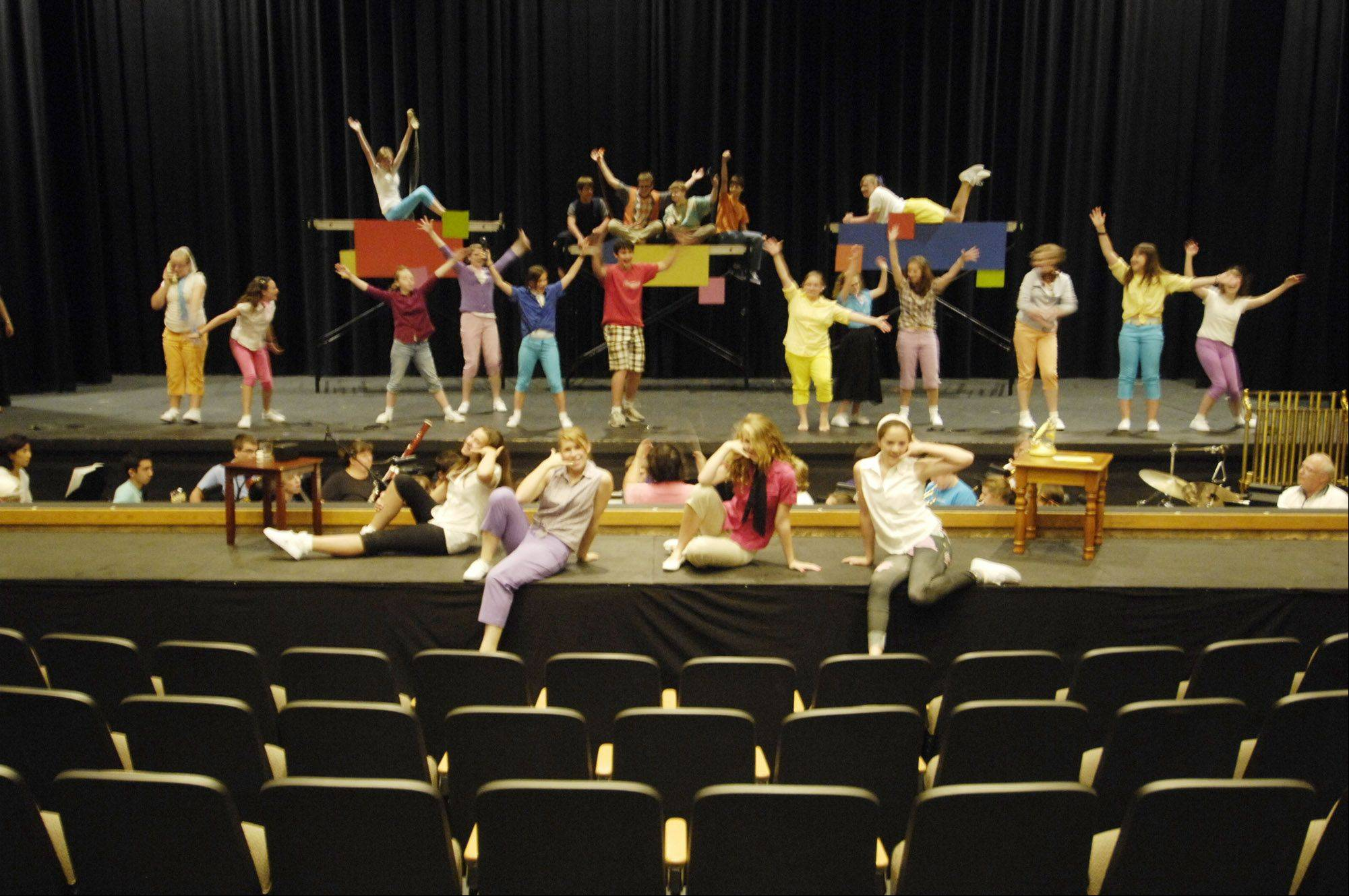 "Cast members rehearse their roles in ""Bye Bye Birdie"" at Kaneland High School. The musical, which is part of the Kaneland Community Fine Arts Festival, features children and adults of all ages."