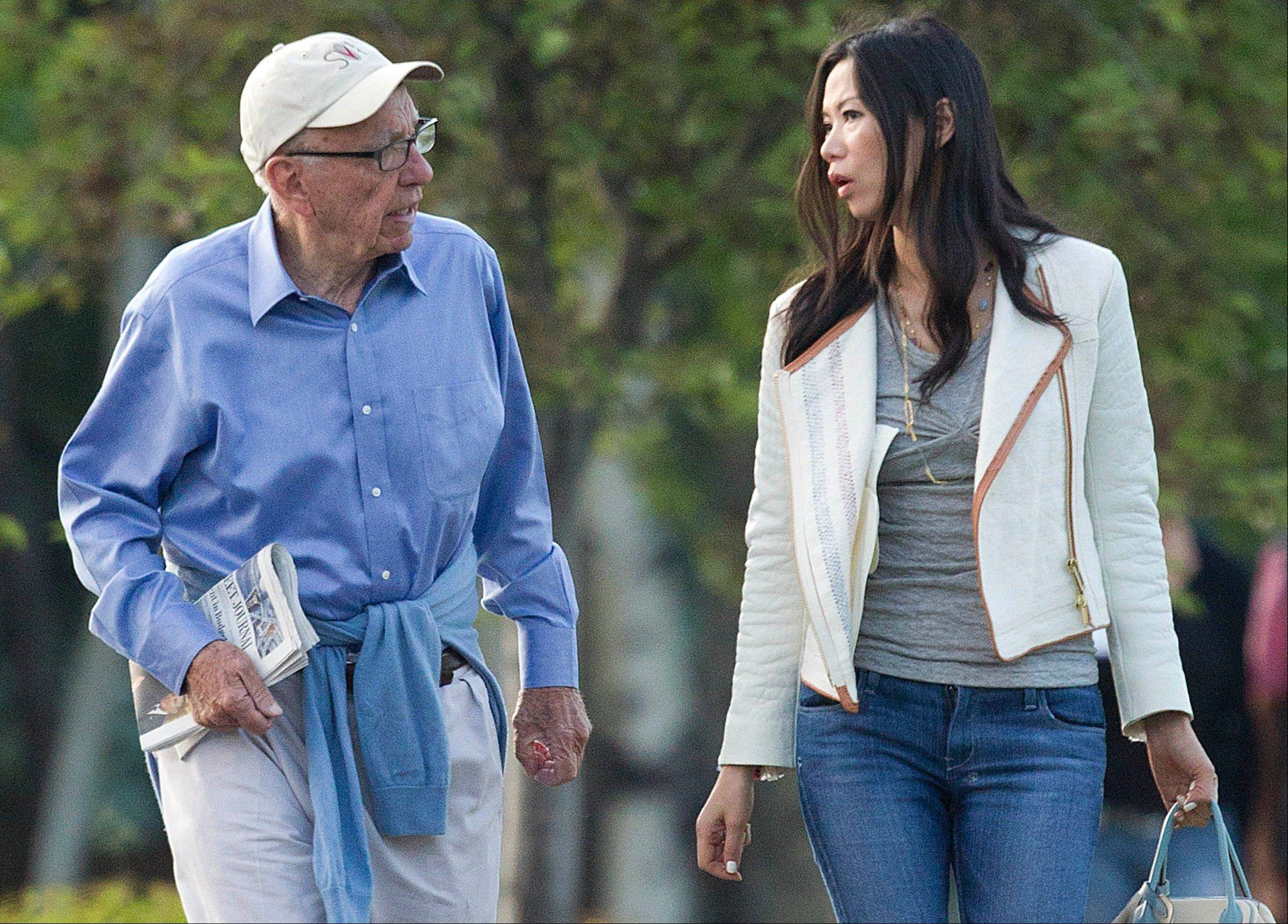 Rupert Murdoch and Wendi Murdoch are seen in Sun Valley, Idaho, Thursday. A Rupert Murdoch-owned tabloid in London was found to have hacked into the phone messages of a teenage murder victim and was suspected of possibly targeting the relatives of slain soldiers in its quest to produce attention-grabbing headlines.