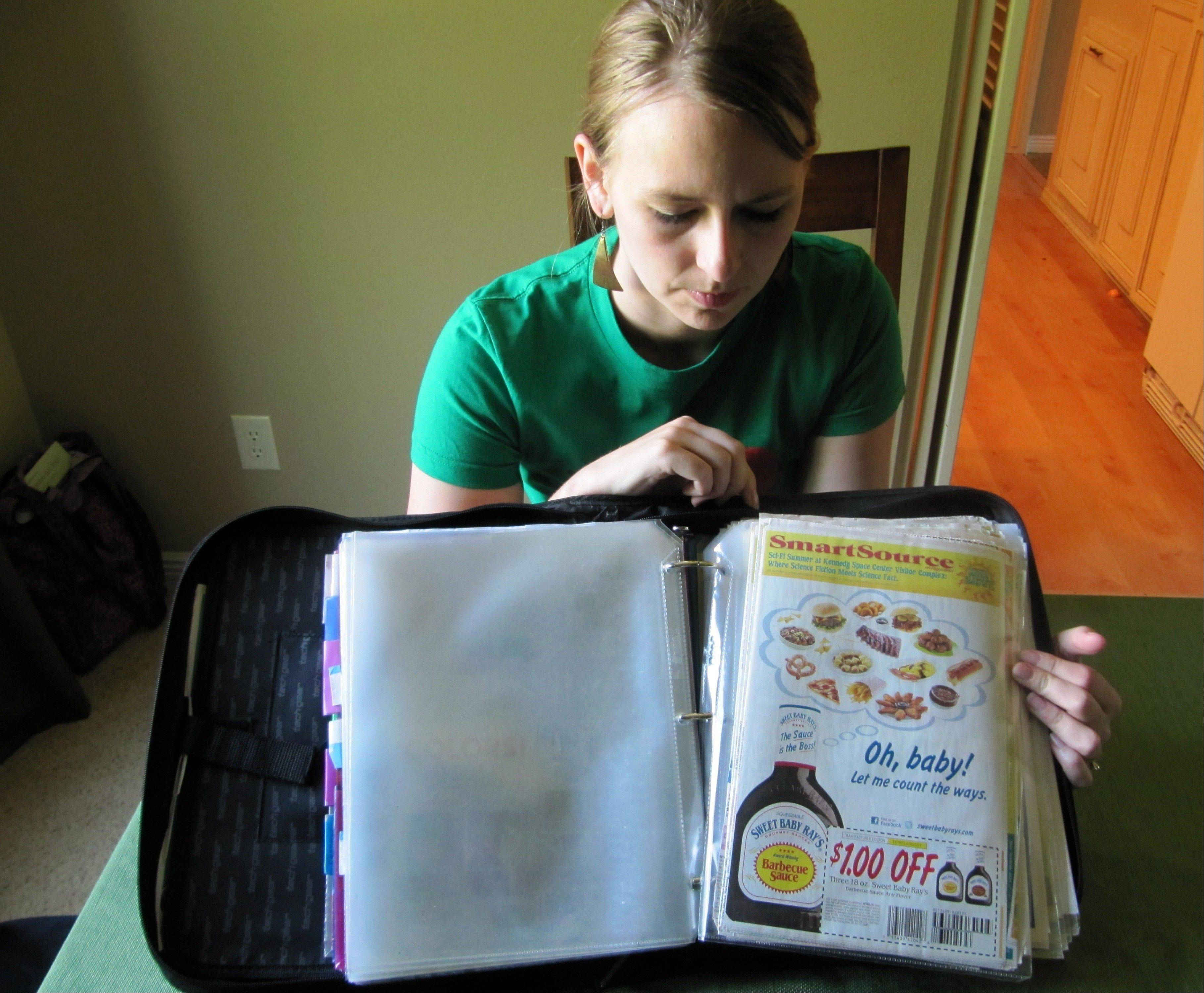 Monica Knight, a dental hygienist and mother of two, shows her coupon binder at her home in Boise, Idaho. Knight used to spend spent $600 a month on groceries. Thanks to extreme couponing she's down to $100 to $150 a month.
