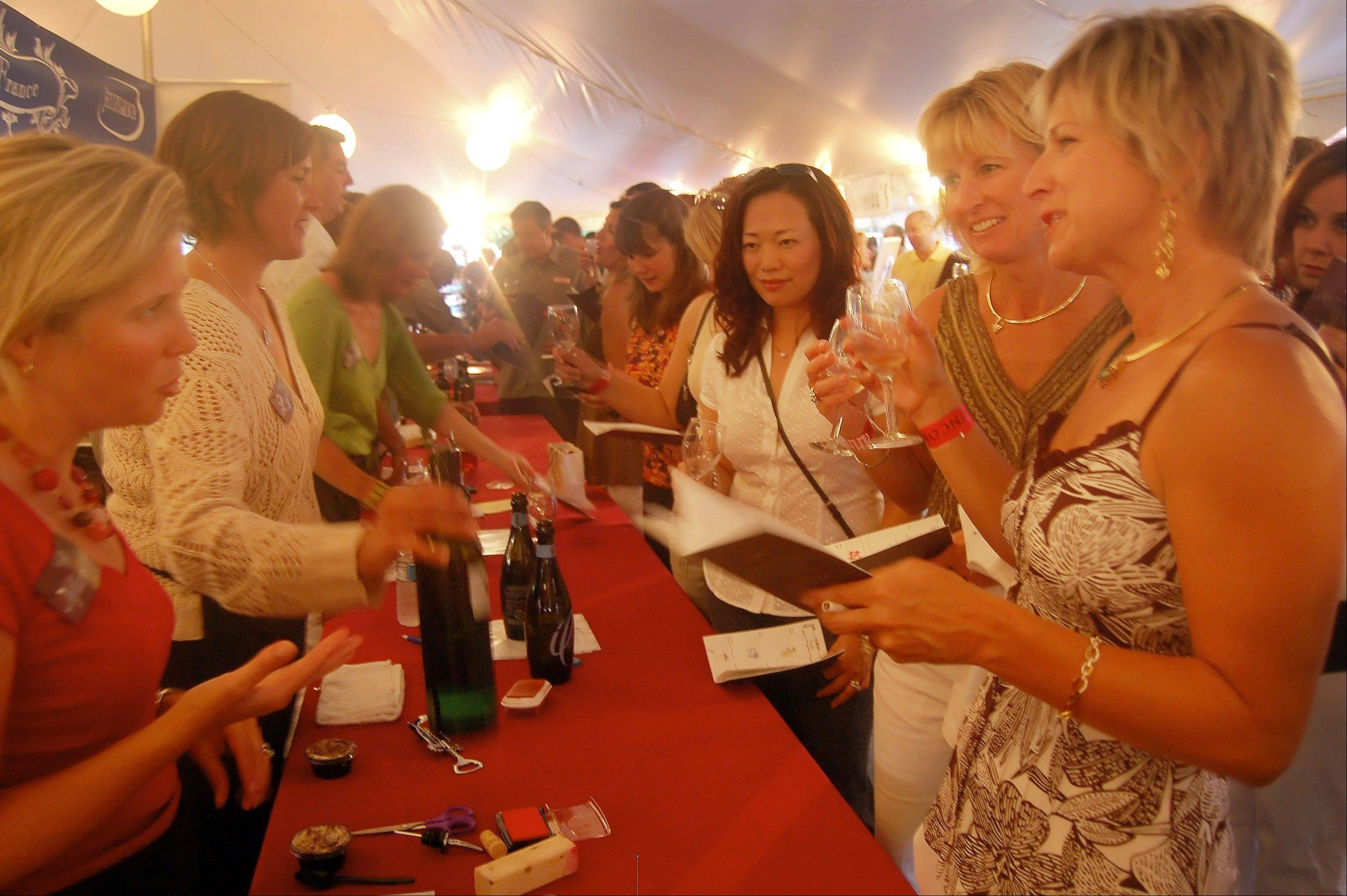 A photo from the 2006 Uncork Barrington shows a group of friends enjoying the evening.