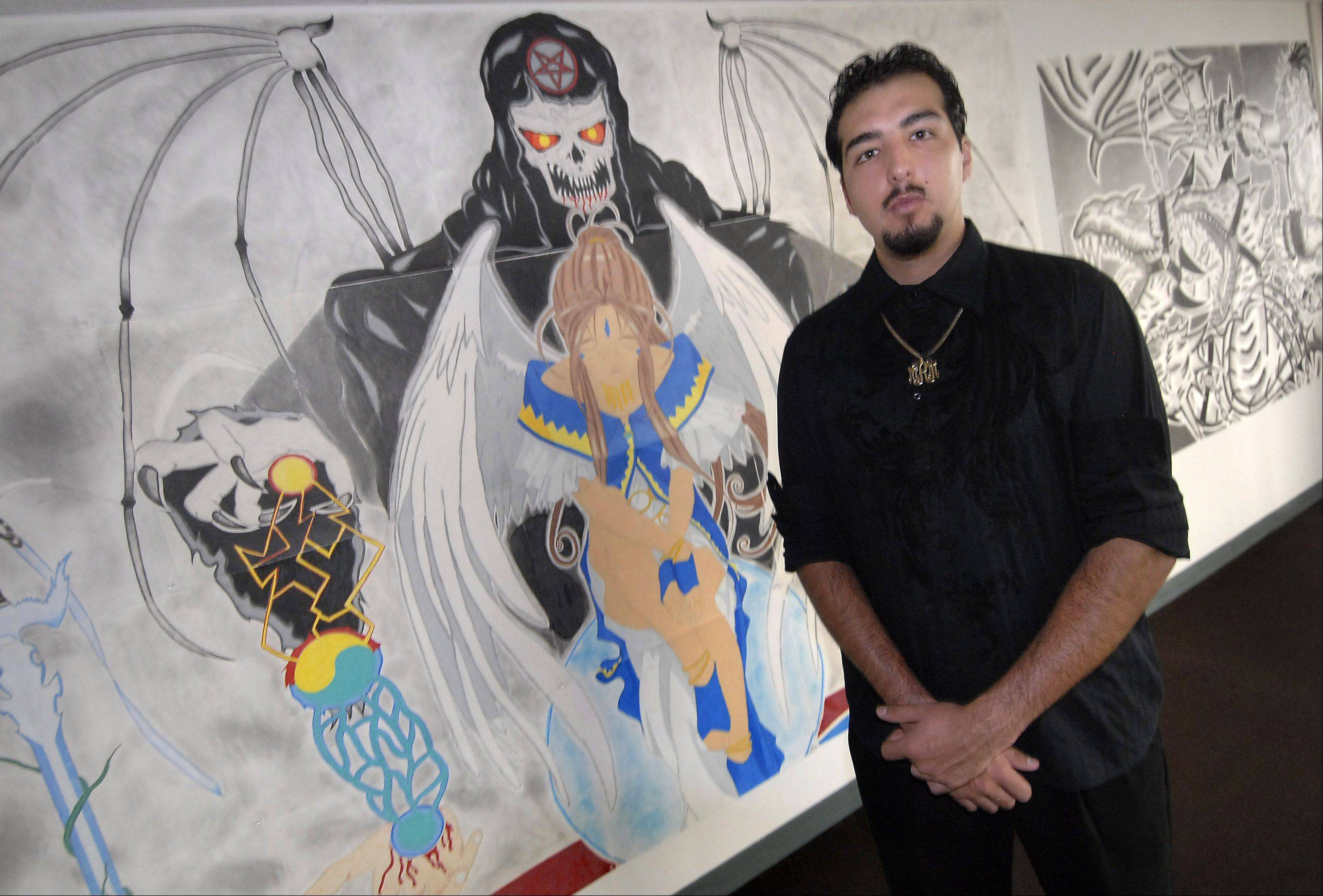 Working in his small apartment in Hanover Park, self-taught artist Raul Maldonado draws his works on pieces of poster board and assembles them later. His largest work, a portion of which is behind him, consists of 81 individual poster boards.