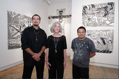 Self-taught artist Raul Maldonado of Hanover Park, left, enjoys his exhibit opening with curator Susan Matthews of the Hanover Park Park District and his assistant, Humberto Ortiz.