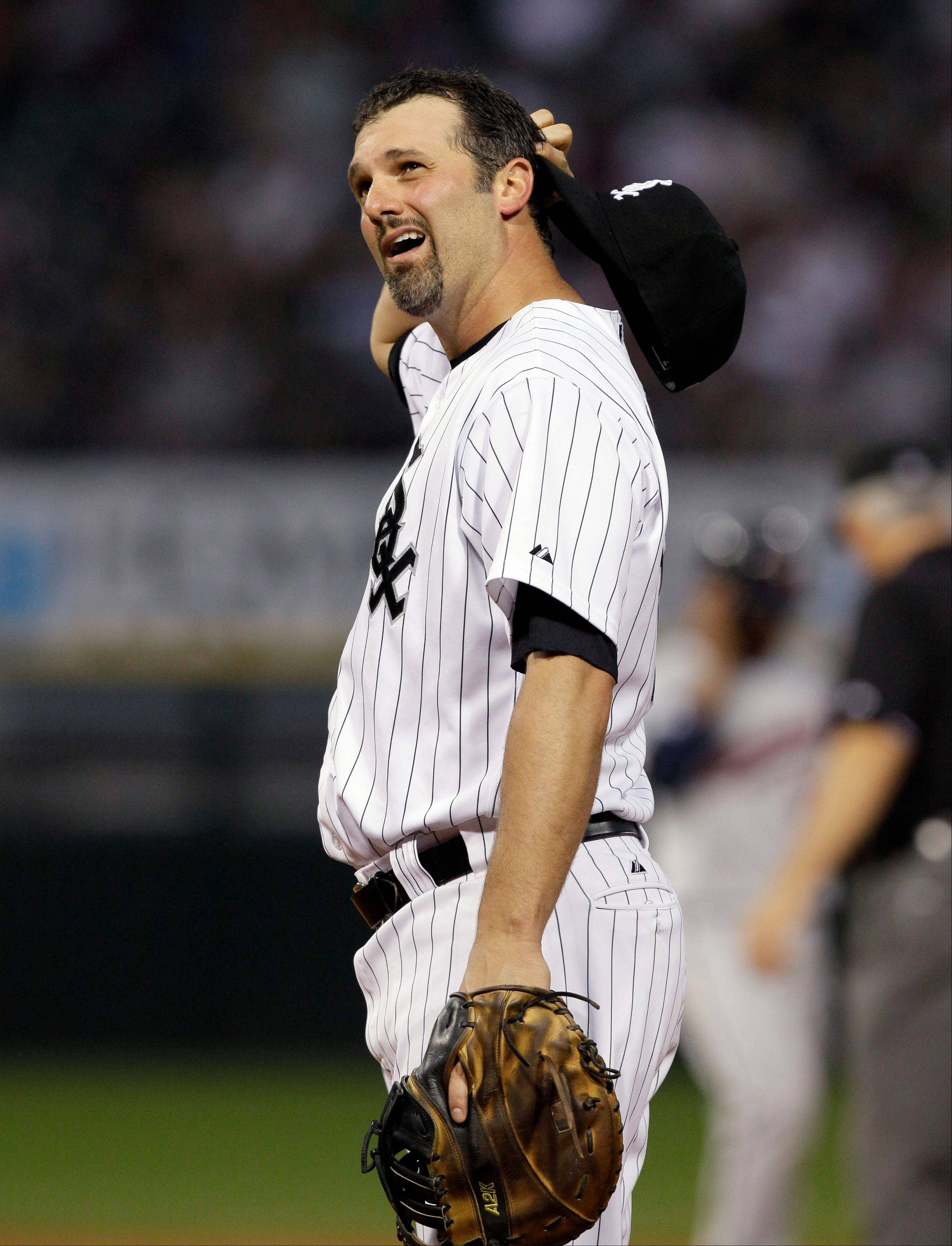 Paul Konerko reacts as he looks up during the fourth inning of a baseball game against the Minnesota Twins Friday, July 8, 2011, in Chicago.