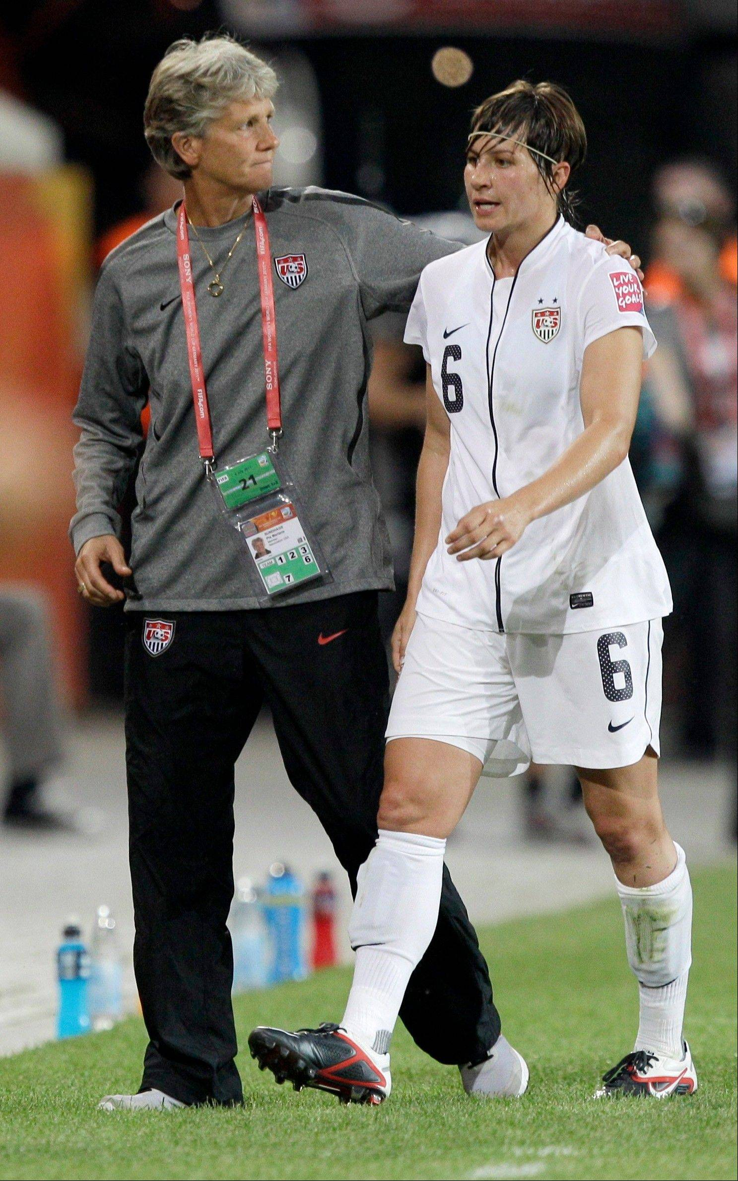 United States coach Pia Sundhage, pats Amy Le Peilbet after she was substituted during Wednesday's Group C match between Sweden and the United States. Sweden won 2-1 to win the group.