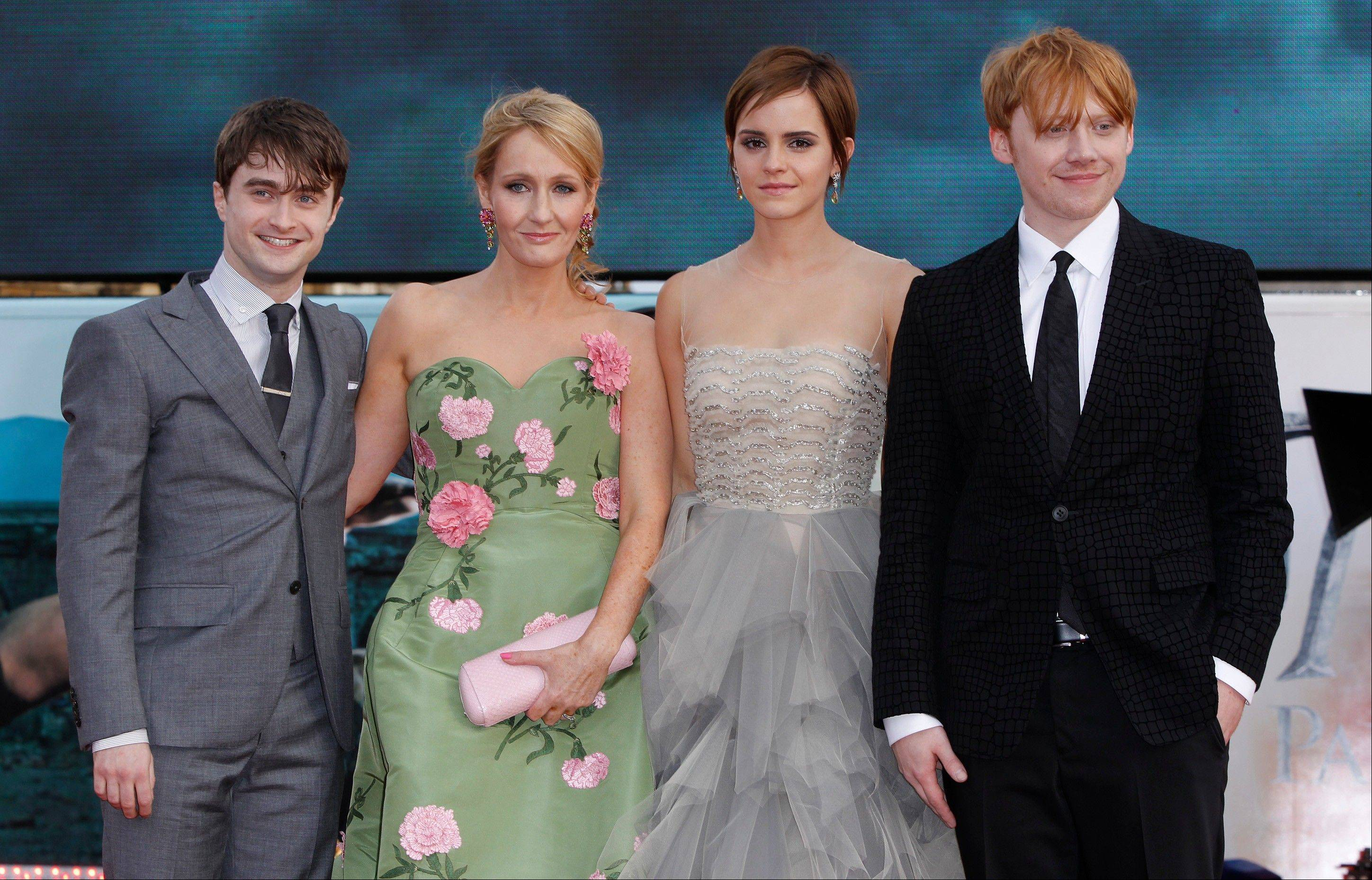 "British author J.K. Rowling, second left, joins actors Daniel Radcliffe, left, Emma Watson and Rupert Grint in Trafalgar Square, central London, for the world premiere of ""Harry Potter and the Deathly Hallows: Part 2"" the last film in the series, Thursday."