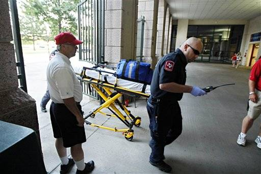 Paramedics arrive at Rangers Ballpark after a Texas Rangers fan fell about 20 feet onto concrete reaching out for a baseball tossed .