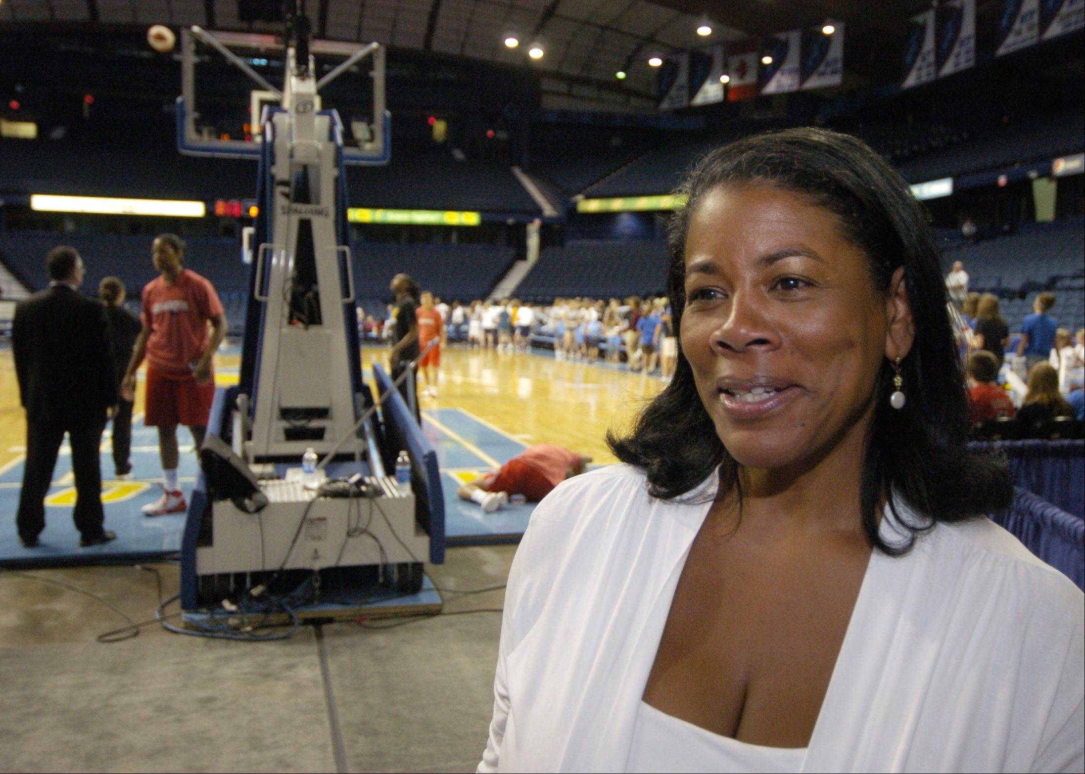 Laurel Richie, president of the WNBA, chats with team personnel prior to a Chicago Sky game at the Allstate Arena in Rosemont this week.