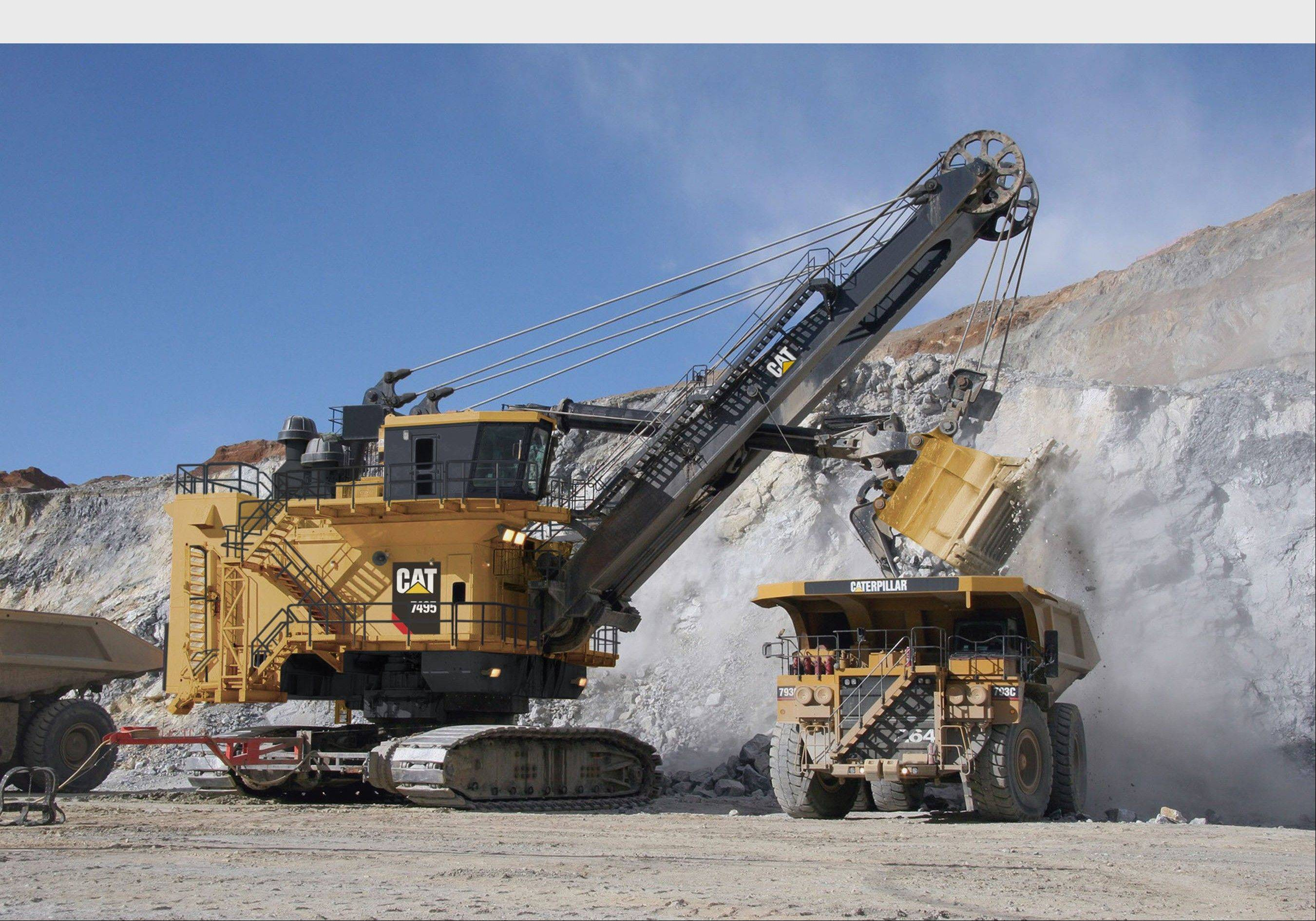 Above is the Cat(R) 7495 Electric Rope Shovel, formerly the Bucyrus 495. This shovel is loading a Cat 793C Mining Truck.