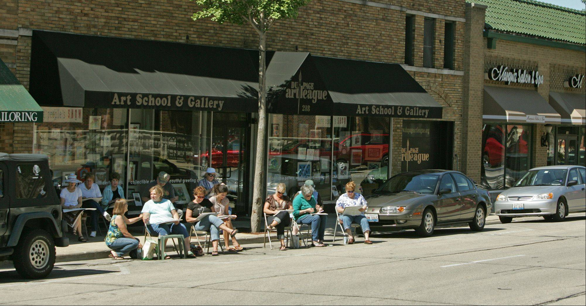 Students work on drawings during a class at the DuPage Art League on Front Street.
