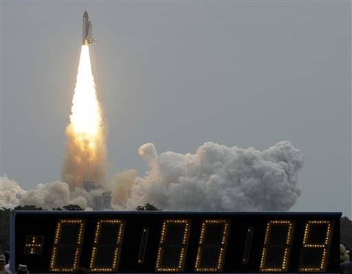 The space shuttle Atlantis lifts off from the Kennedy Space Center Friday.