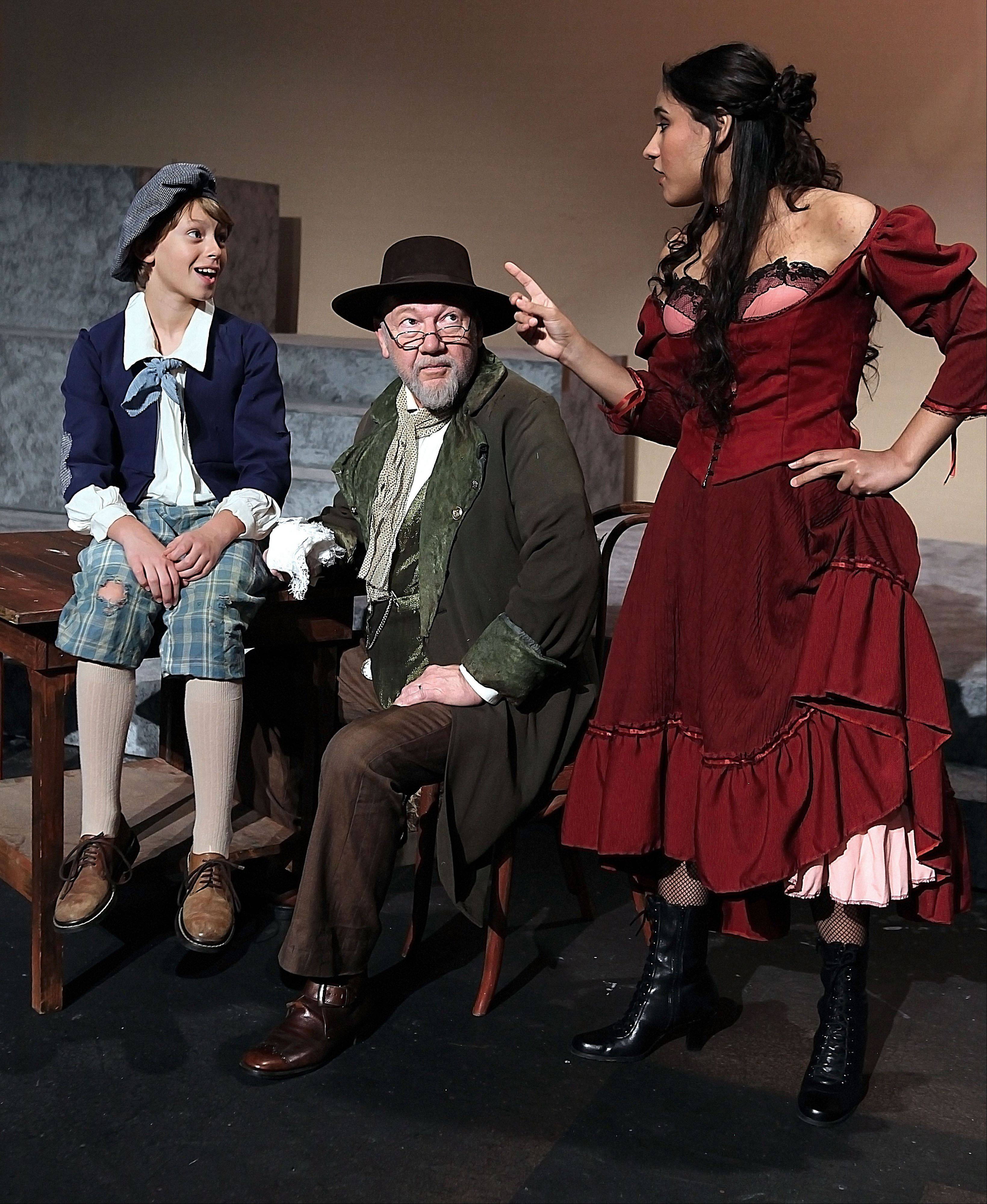 "Matt Schroeder of Gurnee as Oliver, Greg Nevil of Waukegan as Fagin and Ashley Rodriguez of Hainesville as Nancy rehearse a scene from the College of Lake County summer musical, ""Oliver!"""