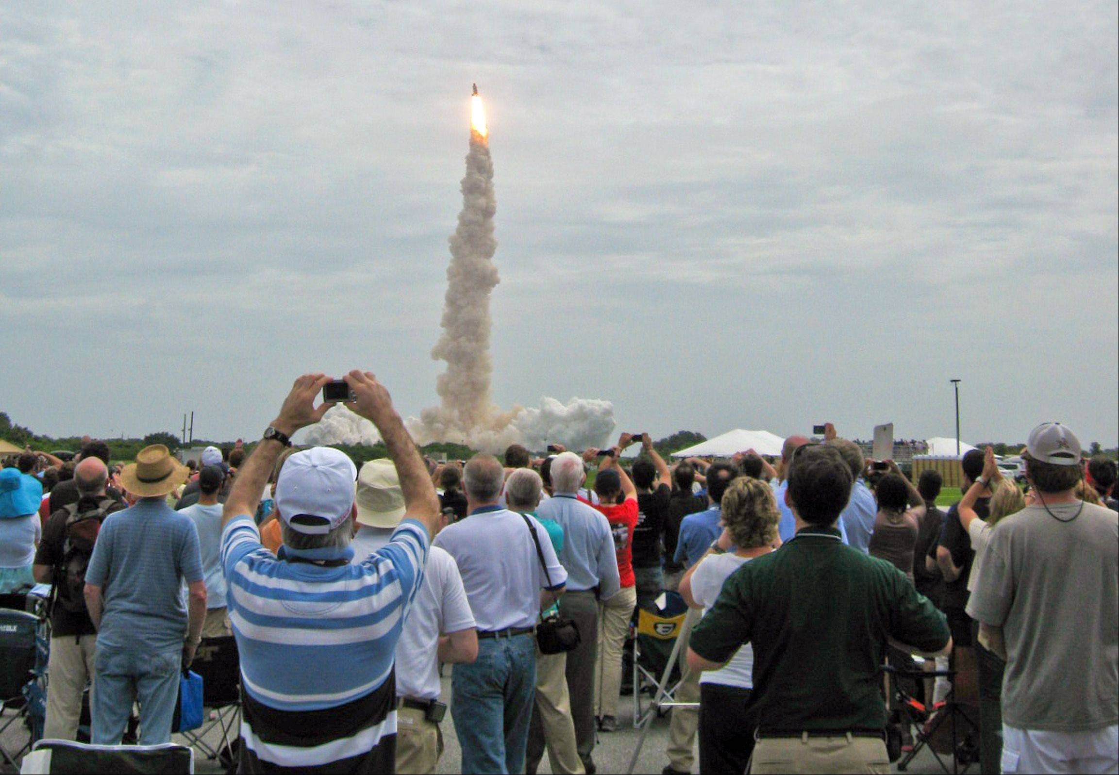 Atlantis lifts off from Launchpad 39A at 11:29:09 a.m. EST Friday. The Carthage Microgravity Team watched the launch from the grounds of KSC, just outside the Launch Control Center.