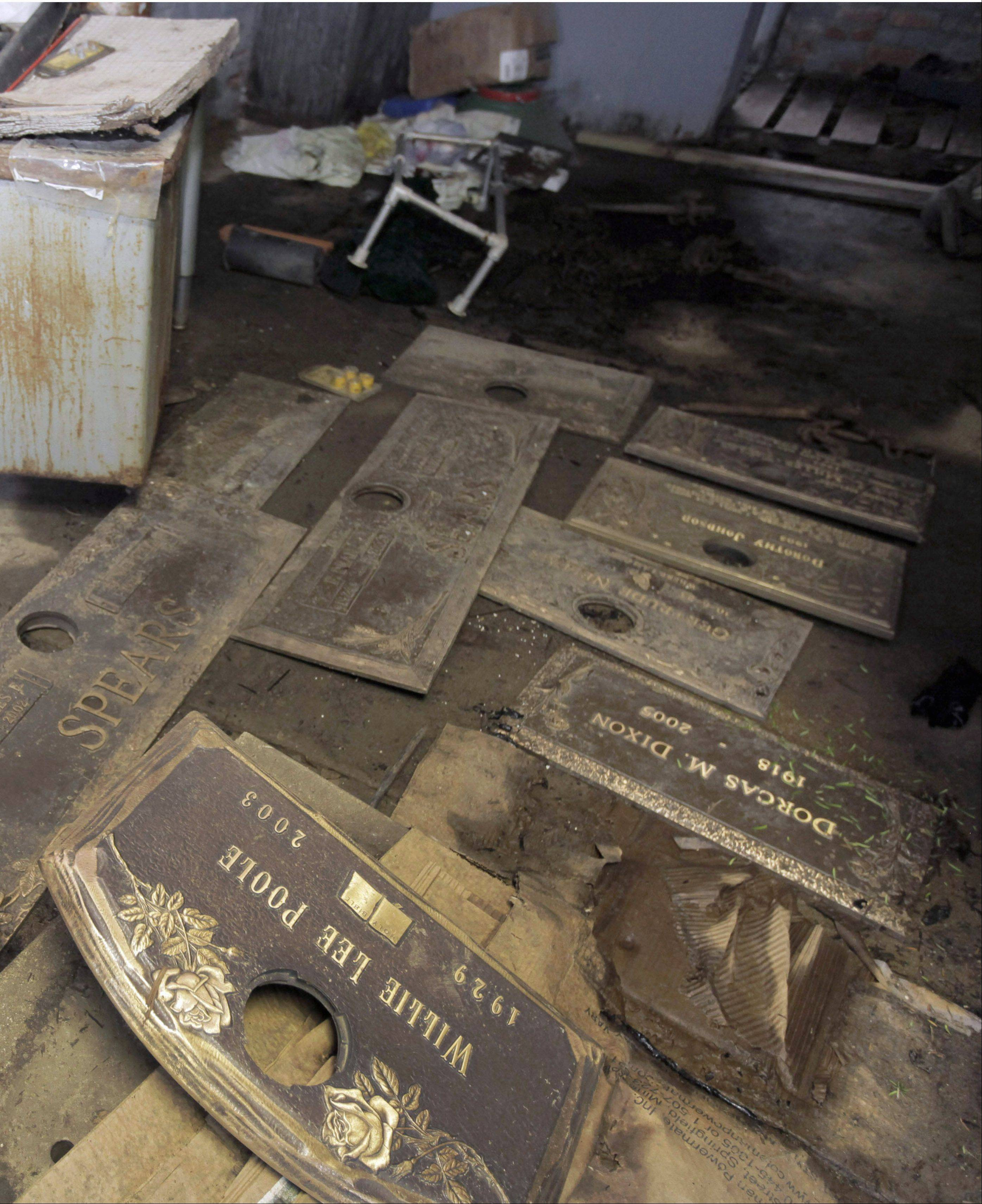 Grave markers were found scattered on the floor of a shack in 2009 at the Burr Oak Cemetery in Alsip. The cemetery's former director pleaded guilty Friday to moneymaking scheme that involved digging up bodies and reselling plots.