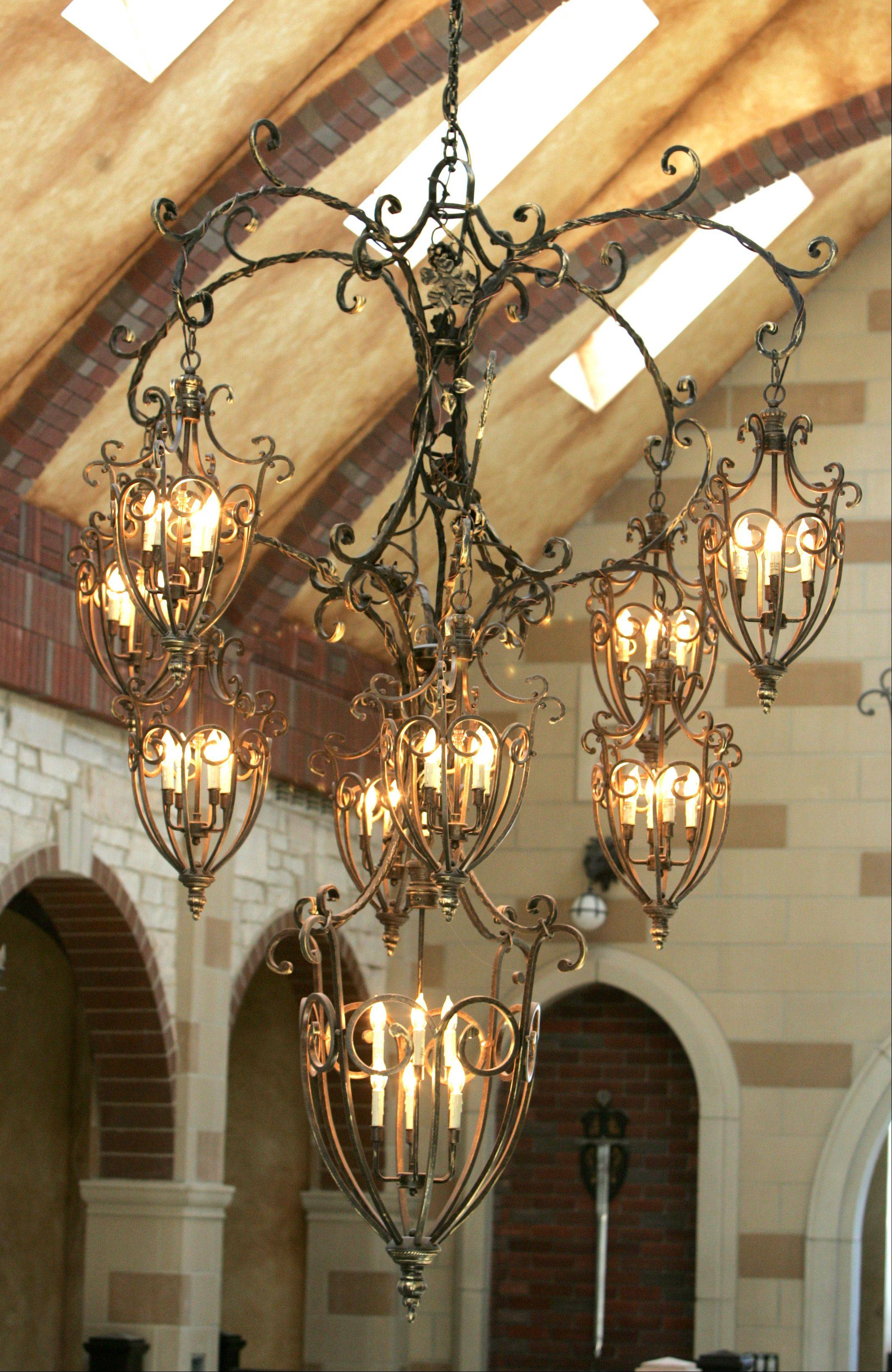 A handmade chandelier is one of many lavish features in the Oak Brook castle.