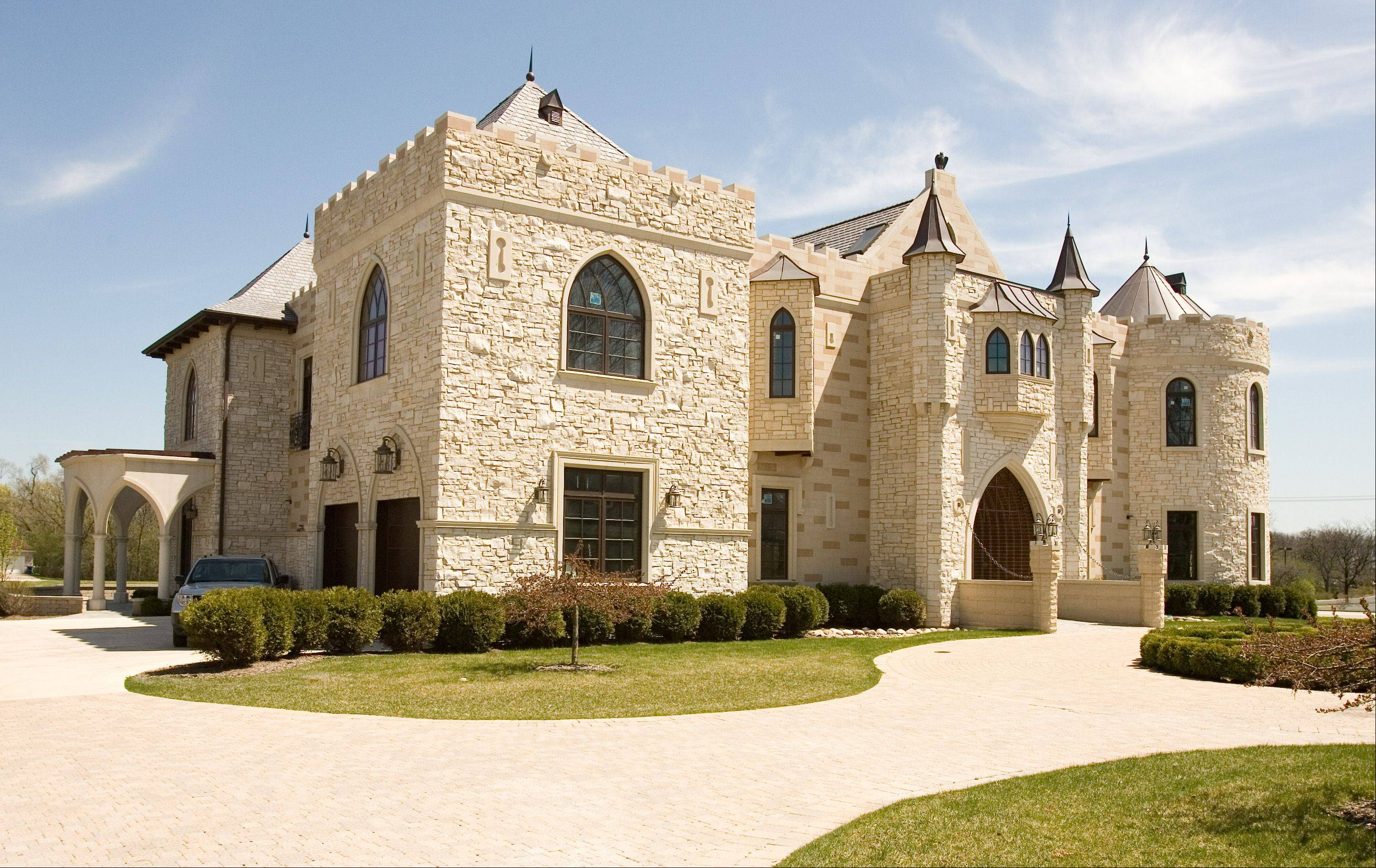 The Oak Brook castle is the first home built by architect Paul Iwanski.