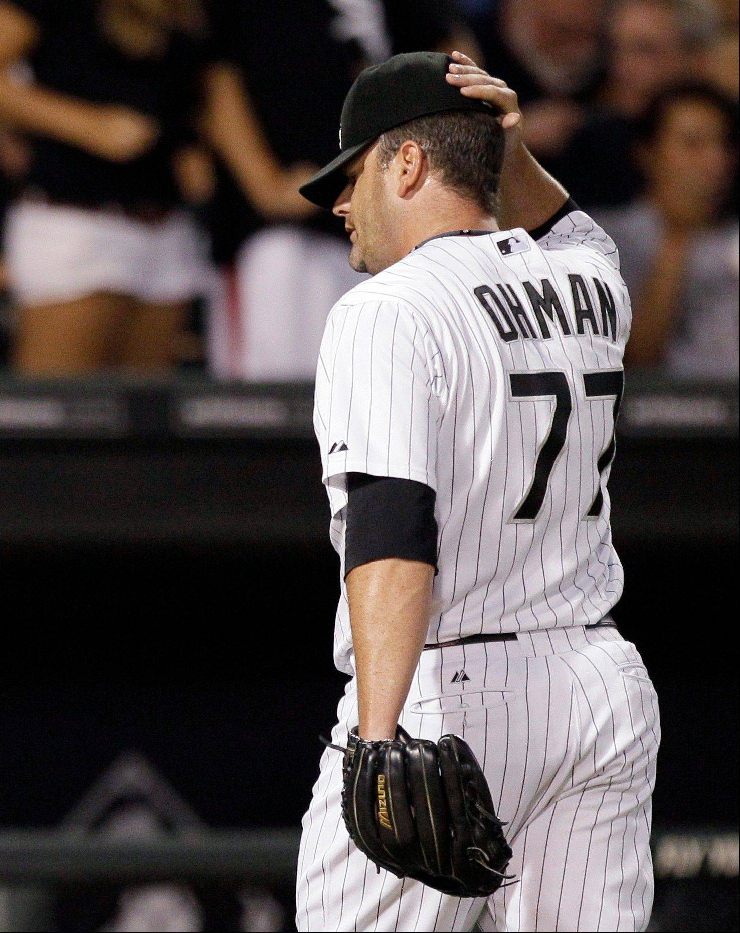 White Sox reliever Will Ohman reacts as he walks back to the dugout after allowing a 3-run homer in the fourth.