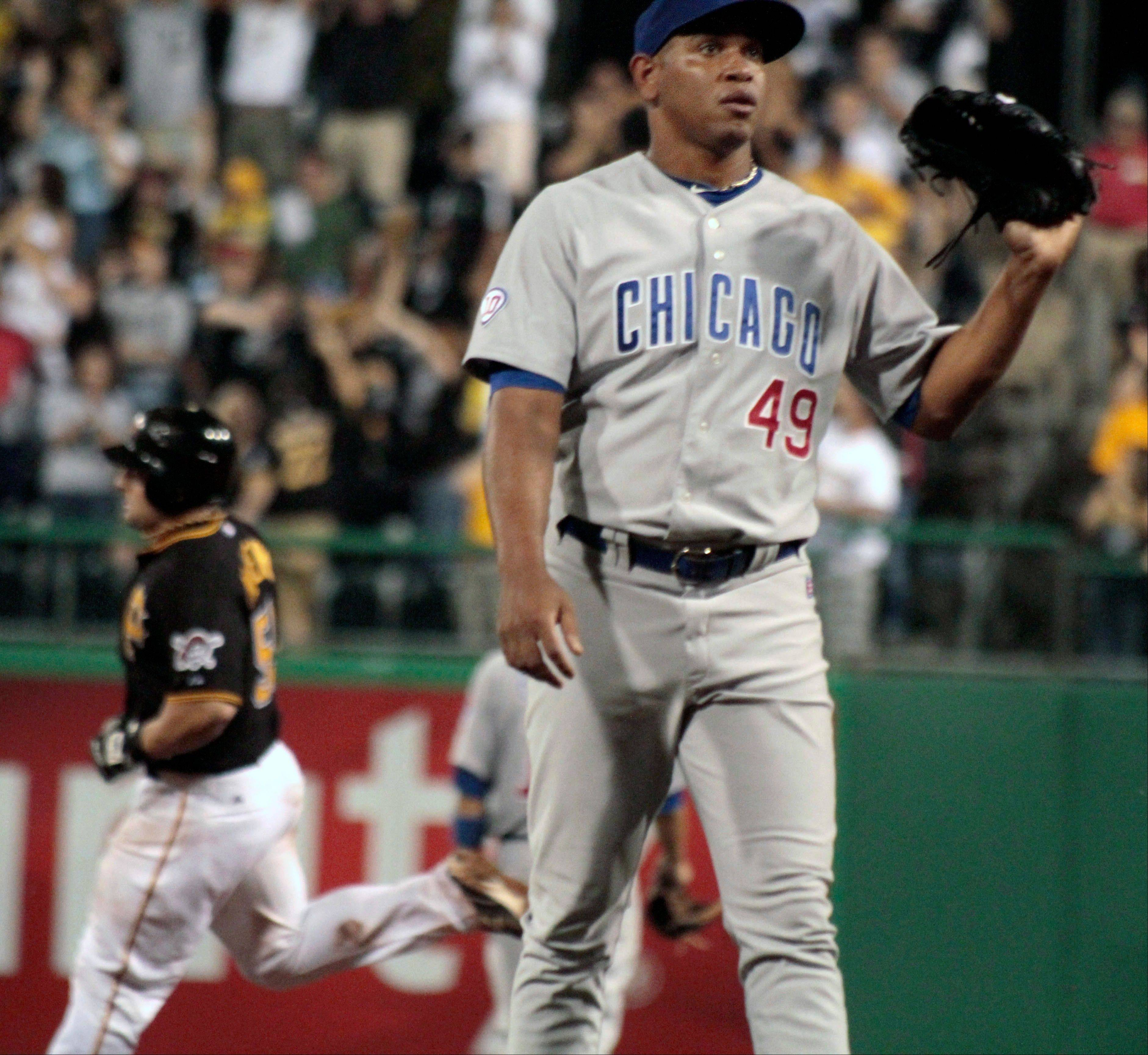 Carlos Marmol awaits a new ball as Pittsburgh's Michael McKenry rounds the bases behind him after hitting a 3-run homer off him in the eighth inning of the Cubs' loss to Pittsburgh.