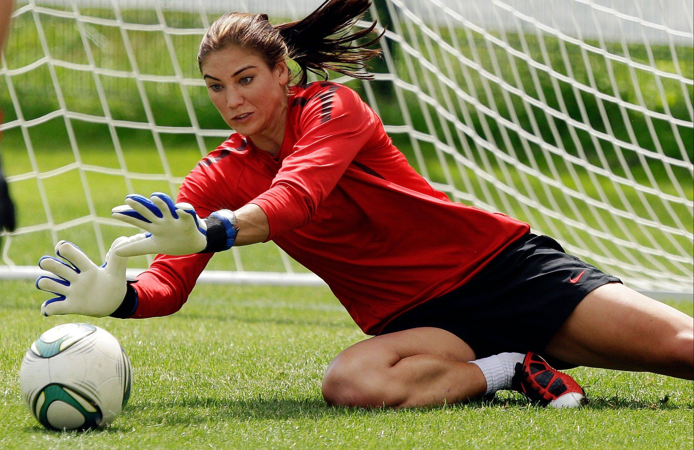 United States goalkeeper Hope Solo stops a shot during practice before the Women's World Cup in Dresden, Germany.