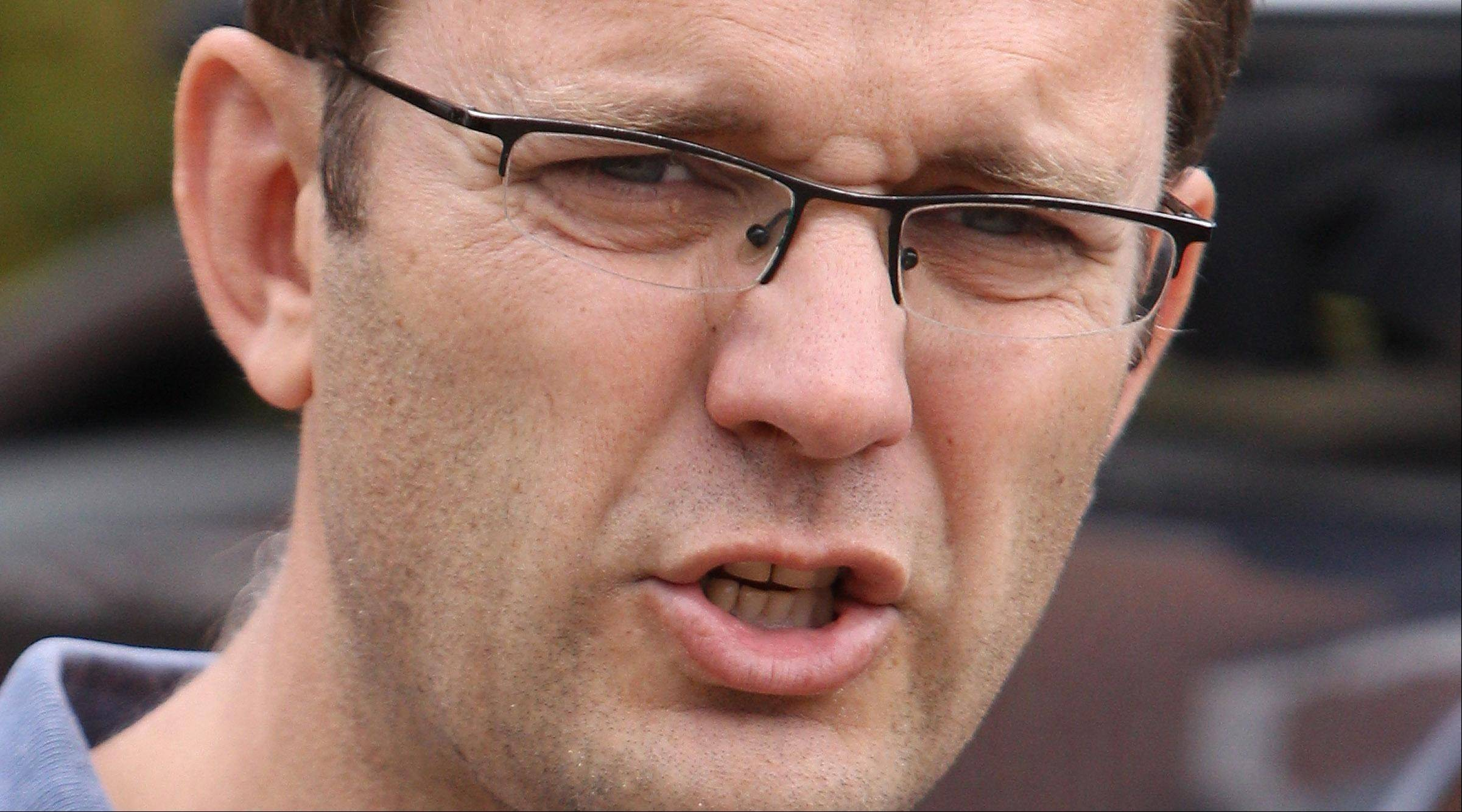 Former British government communication chief and editor of the News of the World Andy Coulson leaves his house in London Saturday.