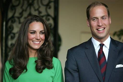 Prince William and Kate, the Duke and Duchess of Cambridge, look on during a private reception at the British Consul-General's residence in Los Angeles, July 8.