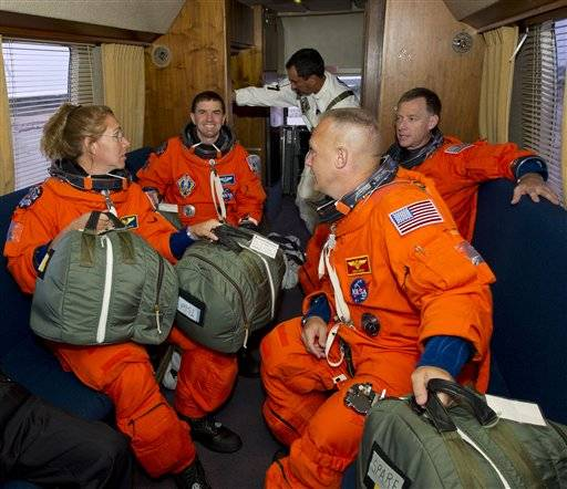Sandra Magnus, mission specialist; Rex Walheim, mission specialist; Chris Ferguson, commander and Doug Hurley, pilot are seen in the Astrovan as they ride to launch pad 39A to board space shuttle Atlantis July 8 at the Kennedy Space Center Friday in Cape Canaveral, Fla. Atlantis is the 135th and final space shuttle launch for NASA.