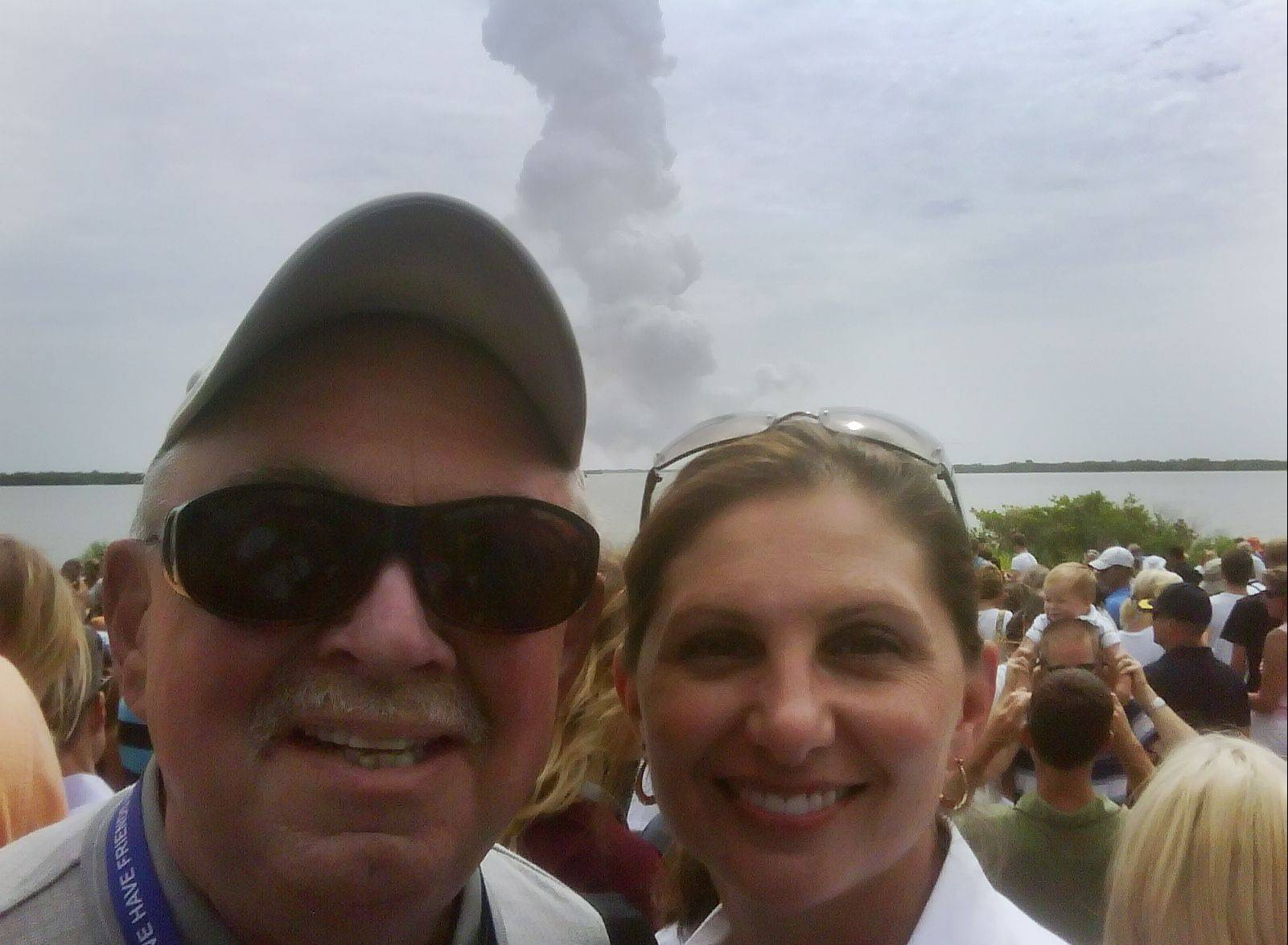 Schaumburg Mayor Al Larson and his daughter, Catherine Koerner, deputy manager of NASA's International Space Station Vehicle Office, a minute after Atlantis launches.