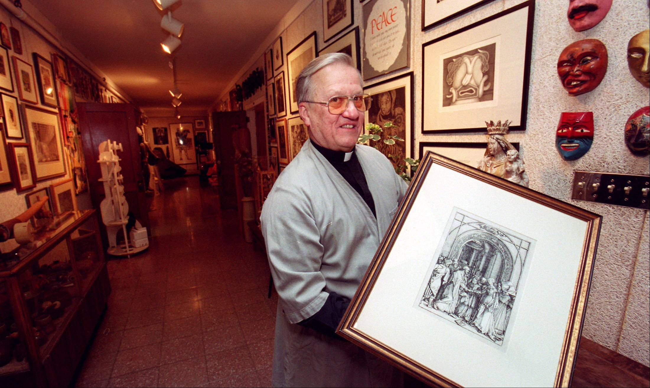 The late Rev. Michael Komechak, holding a 1504 etching titled �Betrothal of the Virgin� by Albrecht Durer, was curator of Benedictine University�s art collection and dreamed of a gallery. The university now is raising money to someday build a gallery.