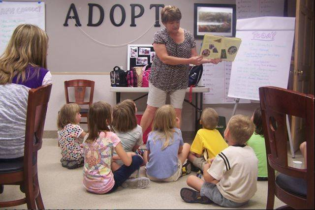 Youngsters in the Camp Paws and Claws program at Naperville-based Animals Deserving of Proper Treatment participate in a variety of activities, including story times.