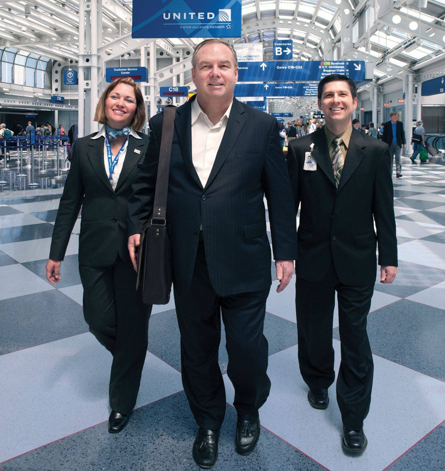Tom Stuker of Bloomingdale, center, on Saturday will become the first customer ever to fly 10 million miles with United Airlines. When he lands at O�Hare at 5 p.m. he will be welcomed by family, friends and airline officials to celebrate his accomplishment.