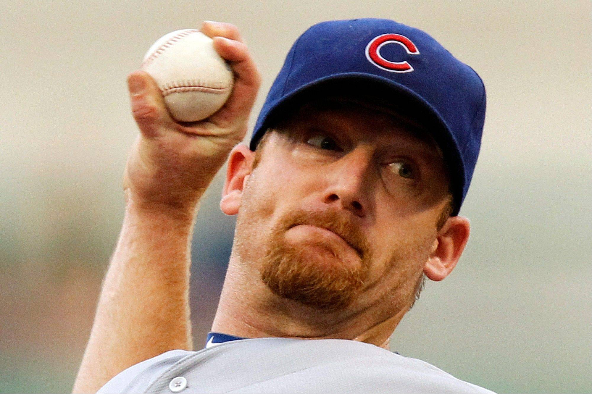 Cubs pitcher Ryan Dempster throws in the first inning Saturday night in Pittsburgh.