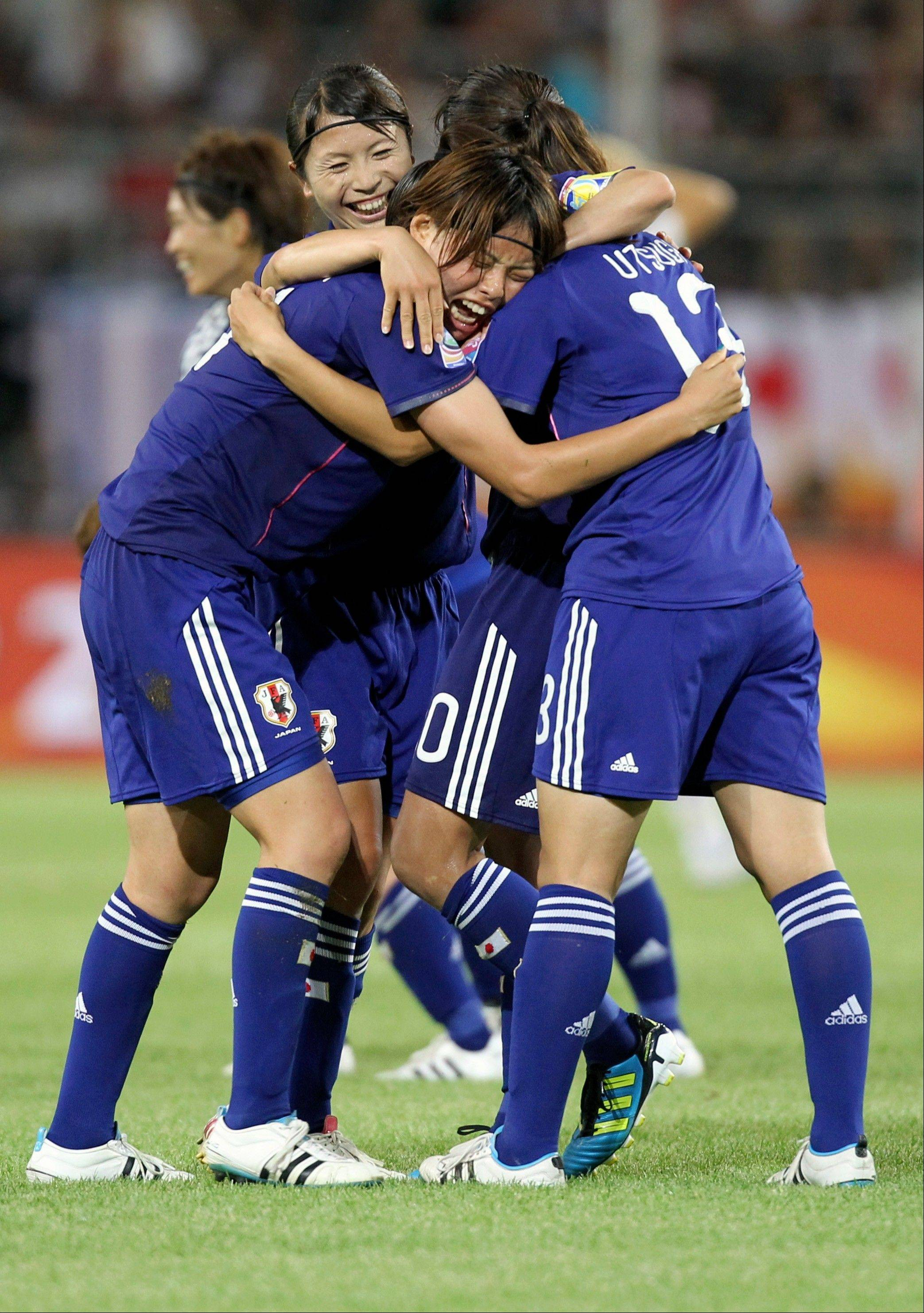 Japan�s players celebrate after winning 1-0 against tournament host Germany in a Women�s World Cup quarterfinal Saturday in Wolfsburg.