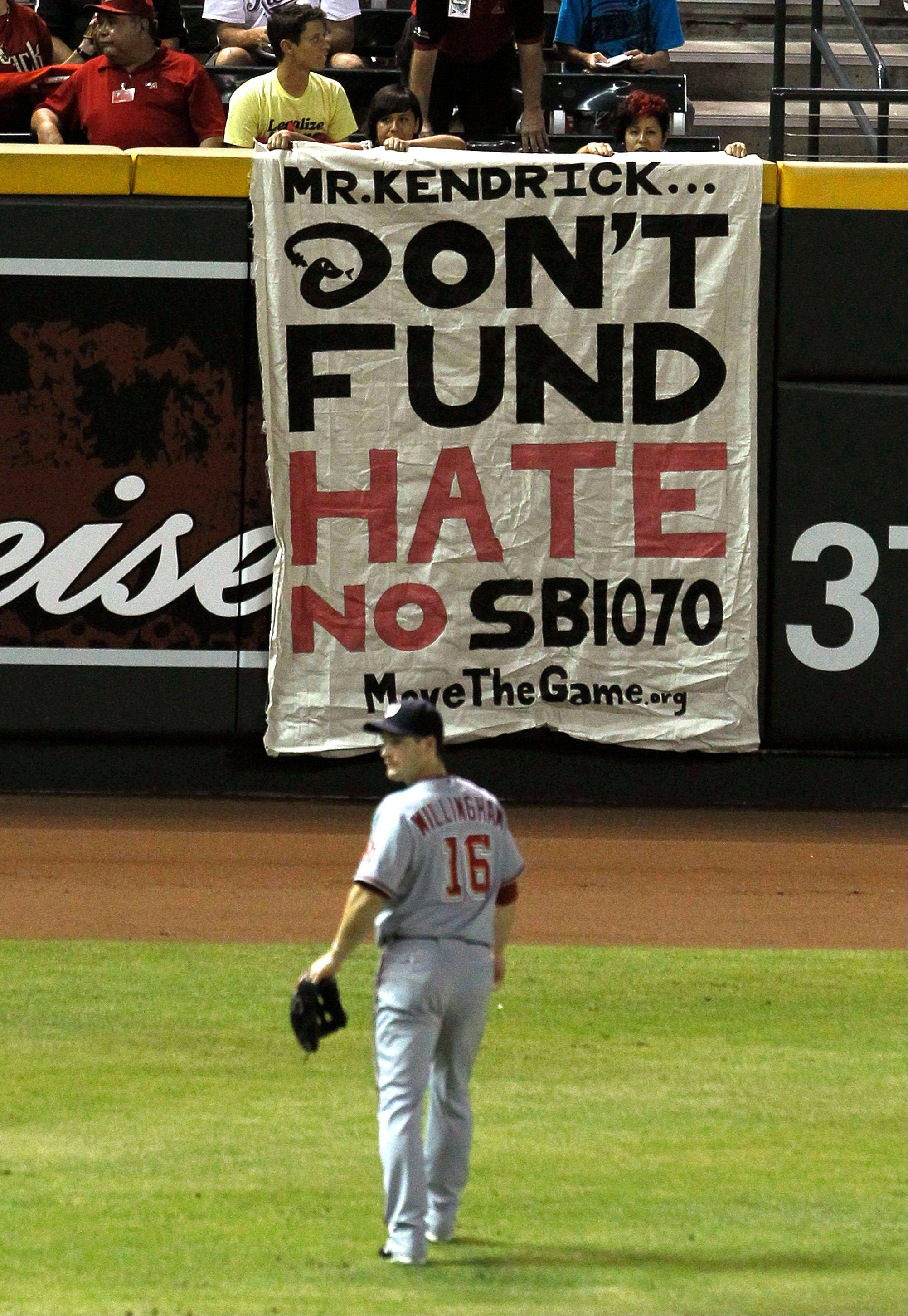 Last summer, protesters hung a banner against the new Arizona immigration law during a game in Phoenix.