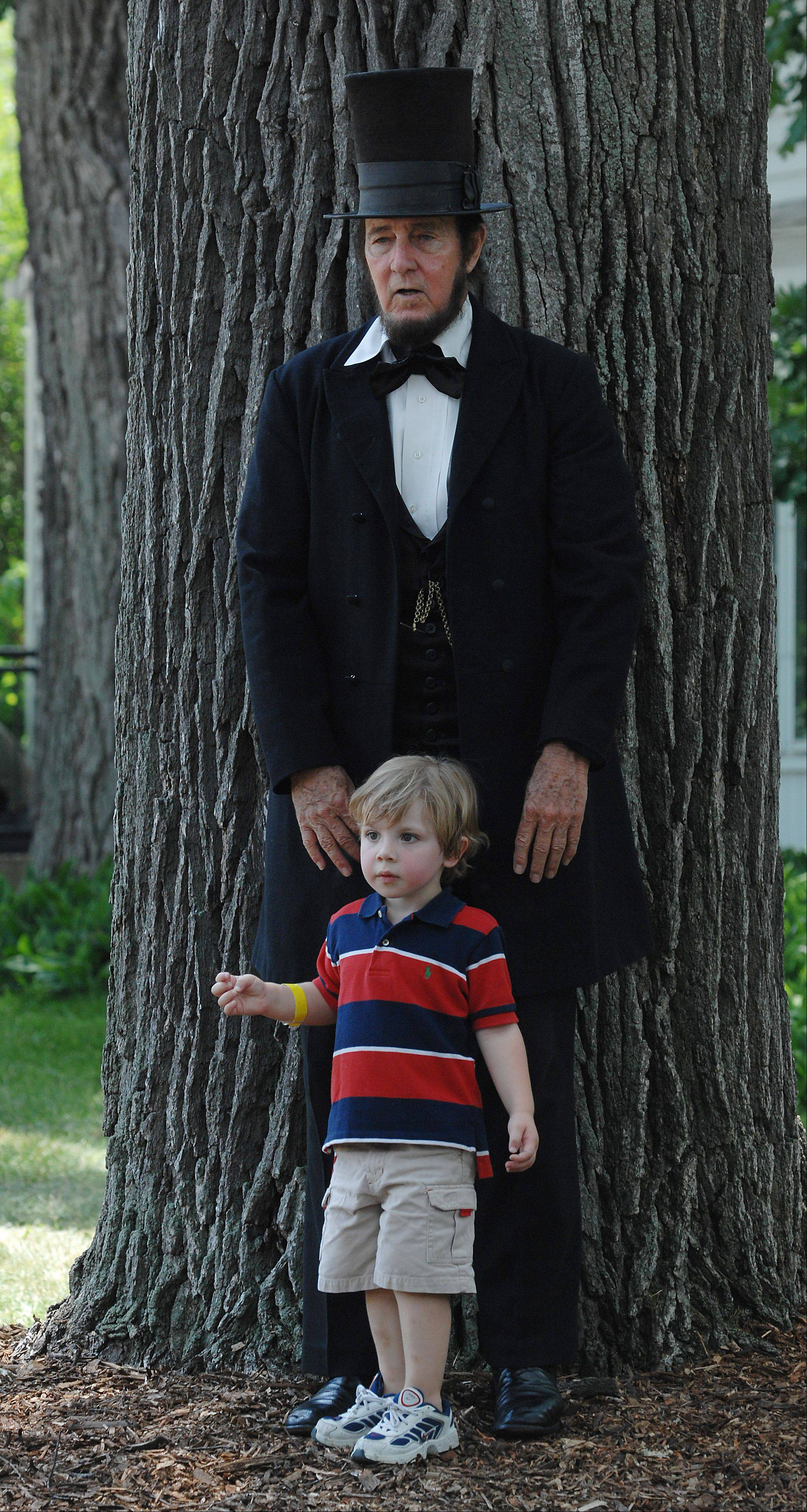 Standing tall is Max Daniels of Wheaton playing the character President Abraham Lincoln against a small Keegan Harlan,2, of Magee Mississippi.