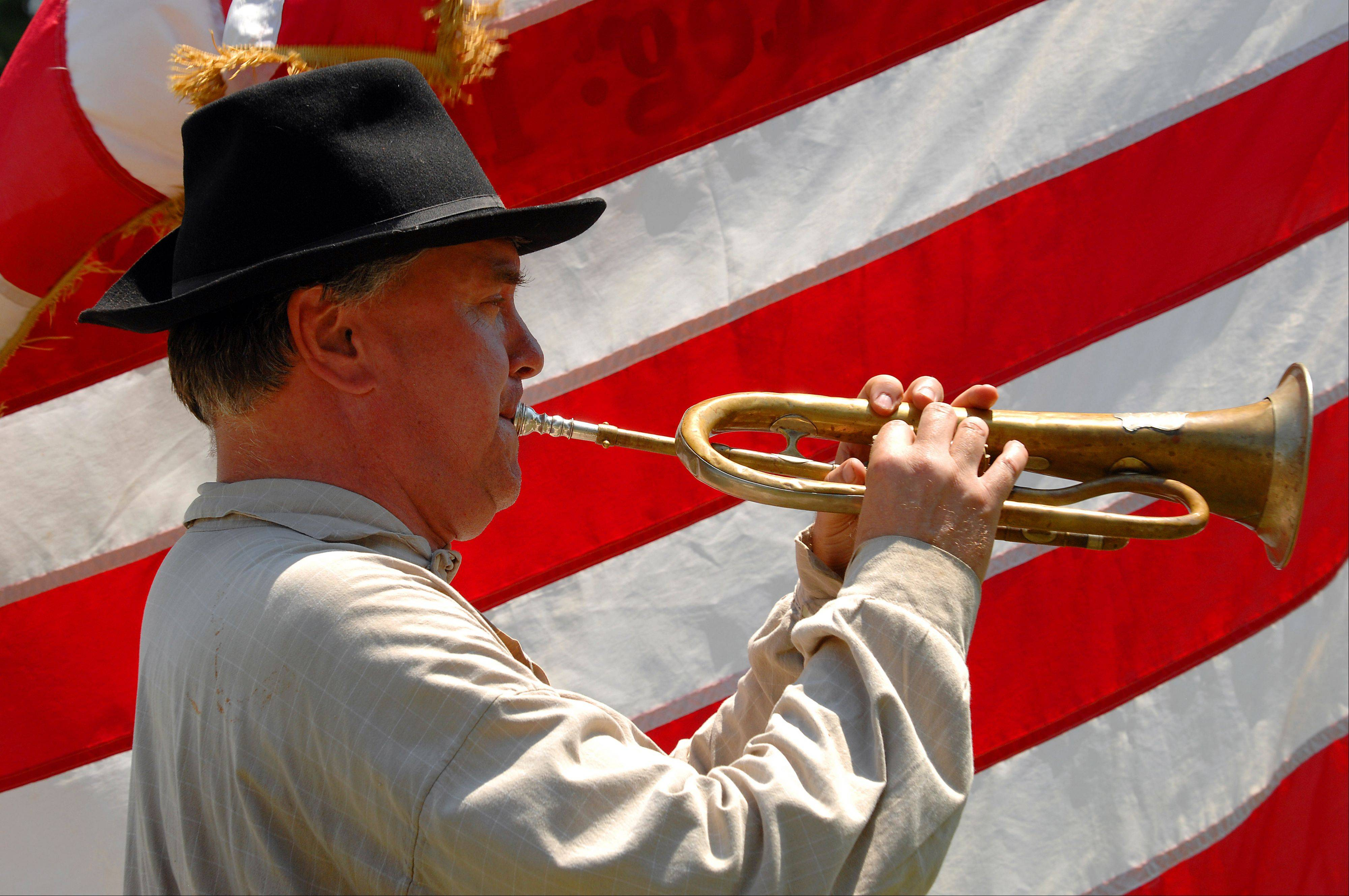 R.J. Samp of Wheaton blows his Fluegel horn against the backdrop of the American flag.