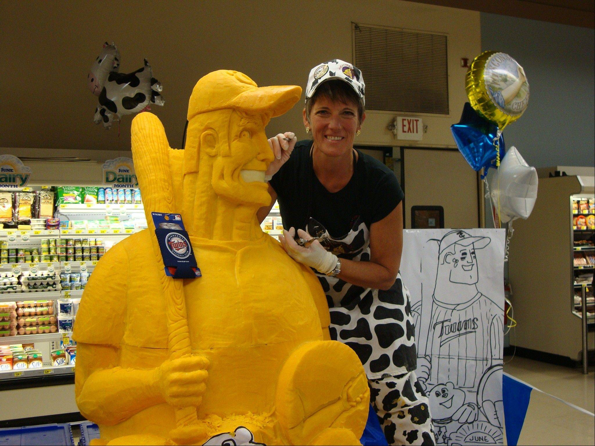 While she does carve busts of real people, cheese sculptor Sarah Kaufmann says she prefers doing mascots and caricatures.