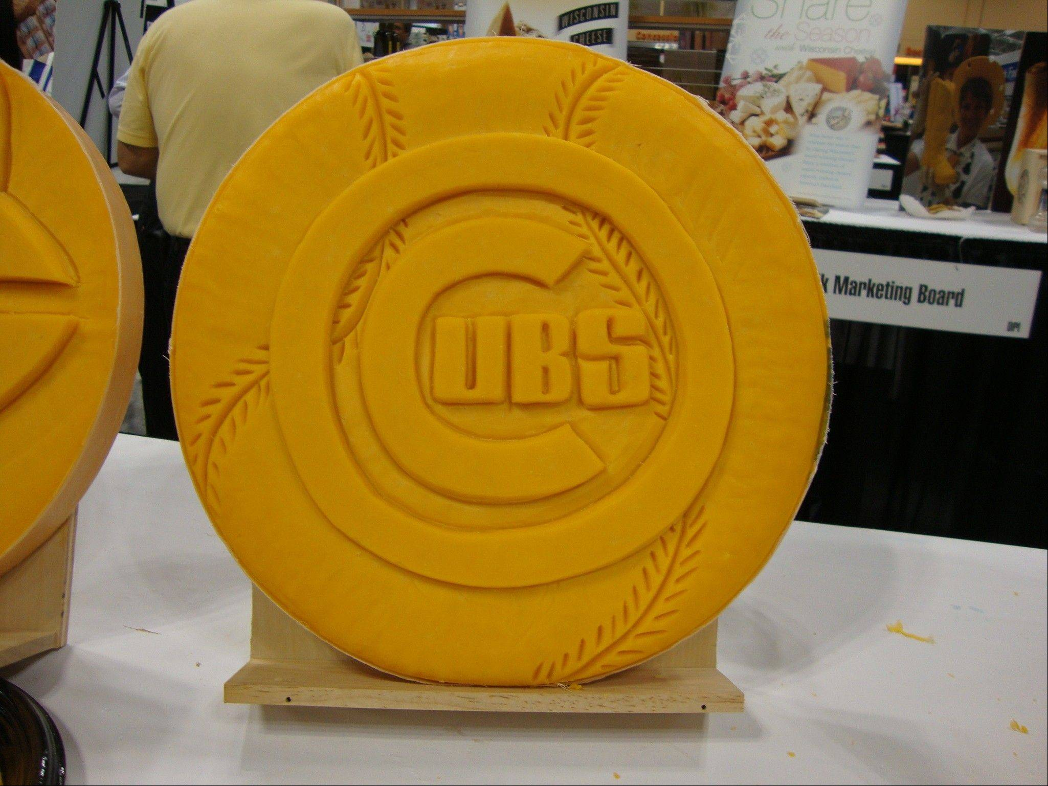 While it might have been appropriate to carve this Cubs logo in a more-stinky cheese this season, cheese sculptor Sarah Kaufmann's medium of choice is cheddar.