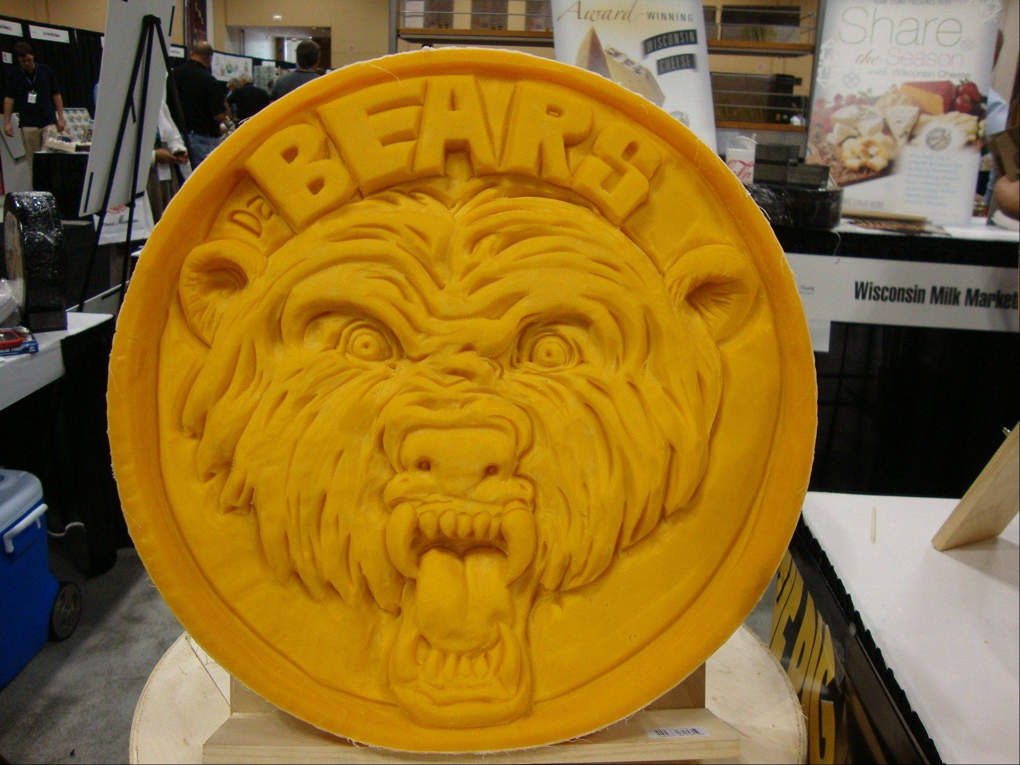 "Proving that even a ""cheese head"" can pay her respects to the Bears, cheese sculptor and Wisconsin native Sarah Kaufmann carves her fromage homage to Chicago."